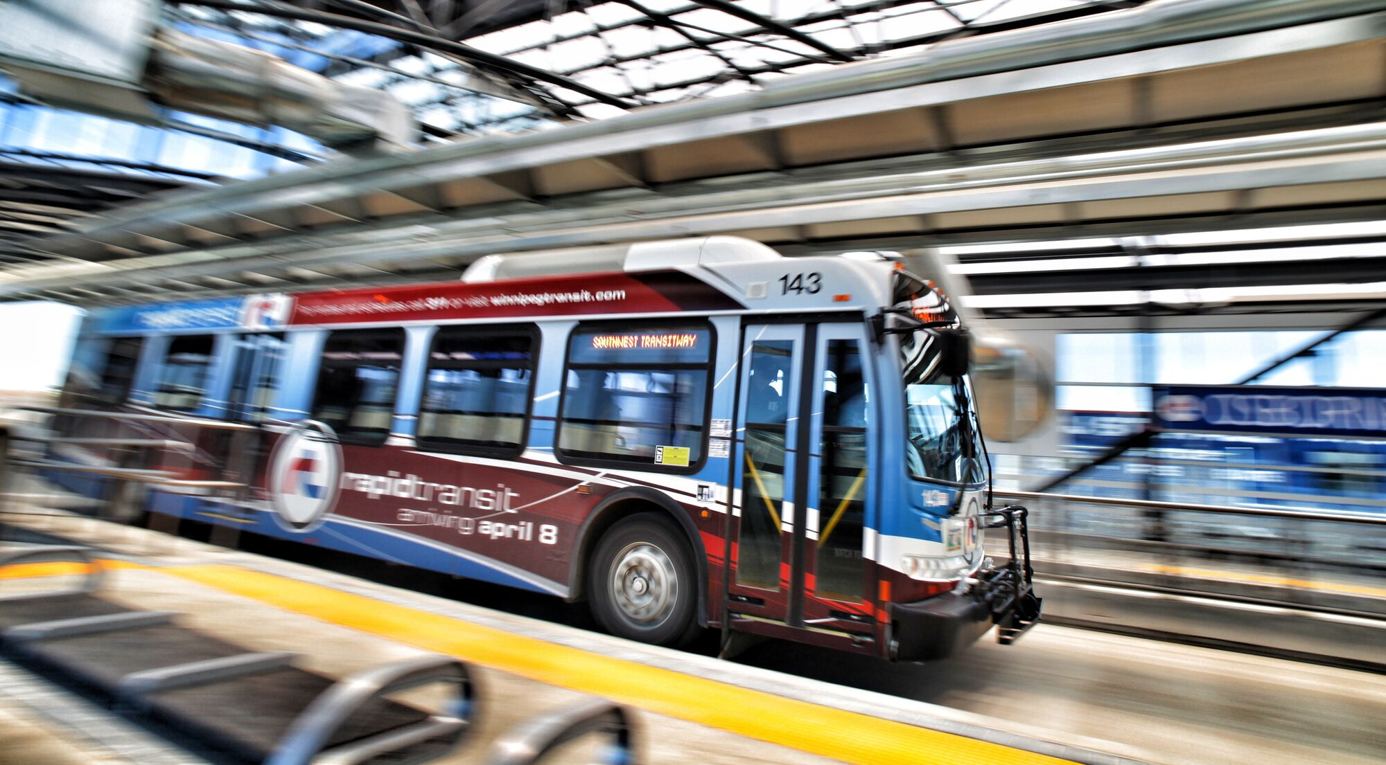 A rapid-transit bus enters the Osborne Street Station on the Southwest Transitway.
