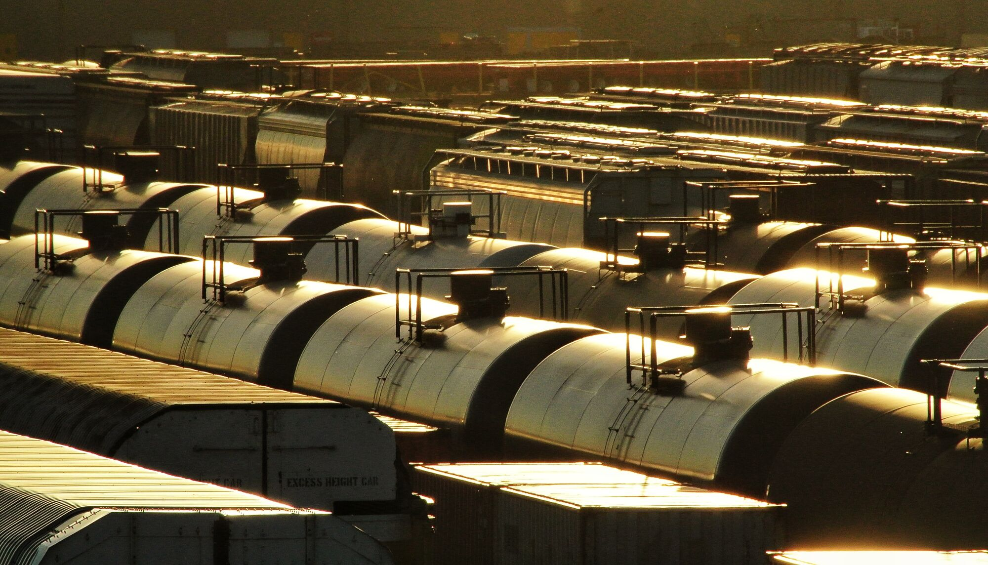 The sunset casts a warm glow on rail cars as they move through the CP Rail yards in Winnipeg.