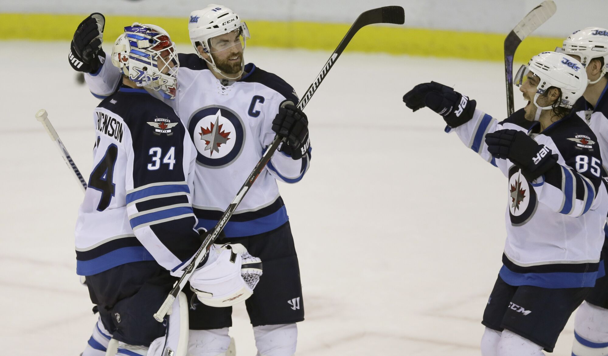 The Jets celebrate their 5-4 shootout triumph over the Detroit Red Wings.