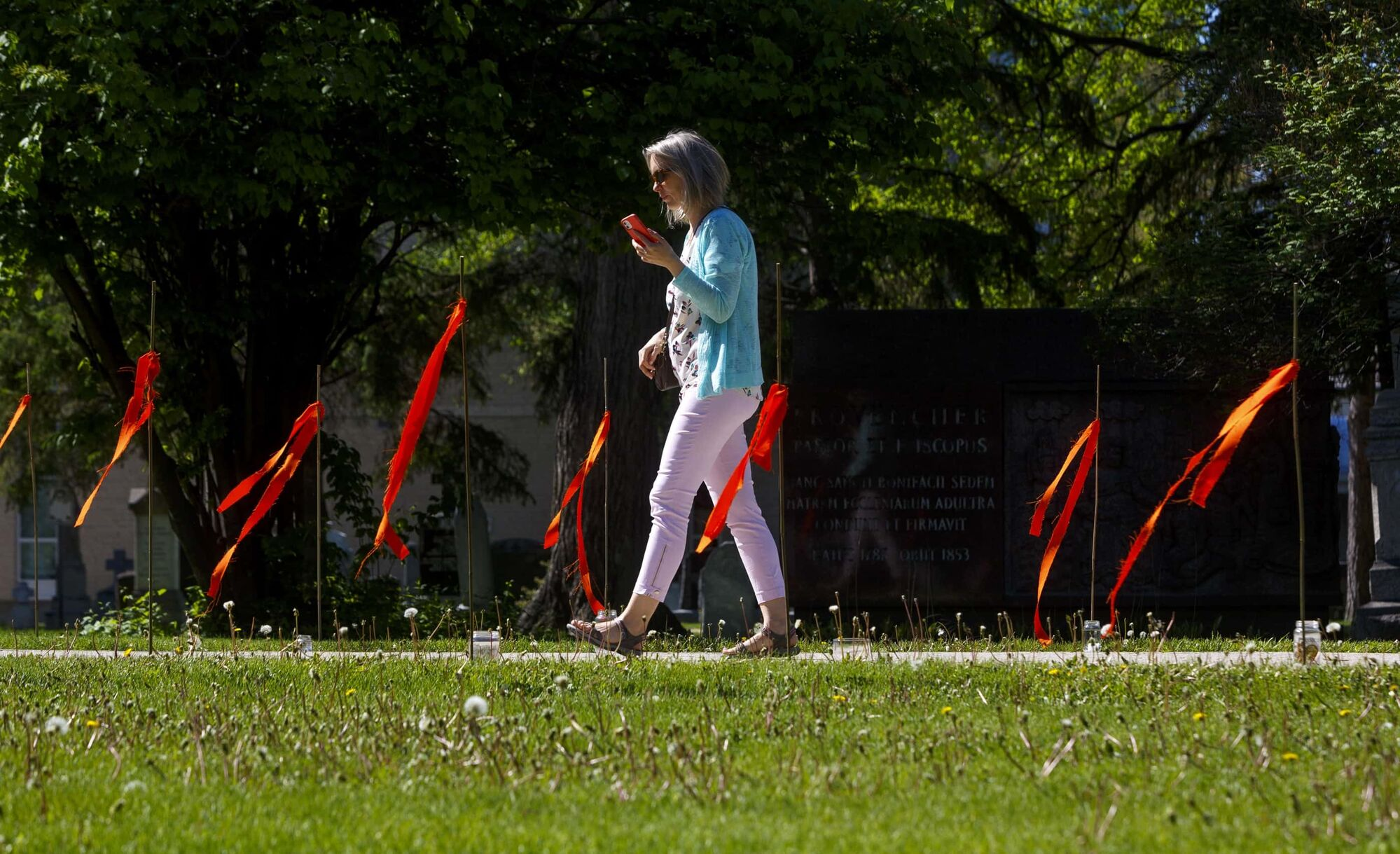 215 orange ribbons line the path to the old St. Boniface Cathedral, a memorial to the 215 children recently found buried in an unmarked gravesite at the former Kamloops Indian Residential School in B.C. (Mike Deal / Winnipeg Free Press files)