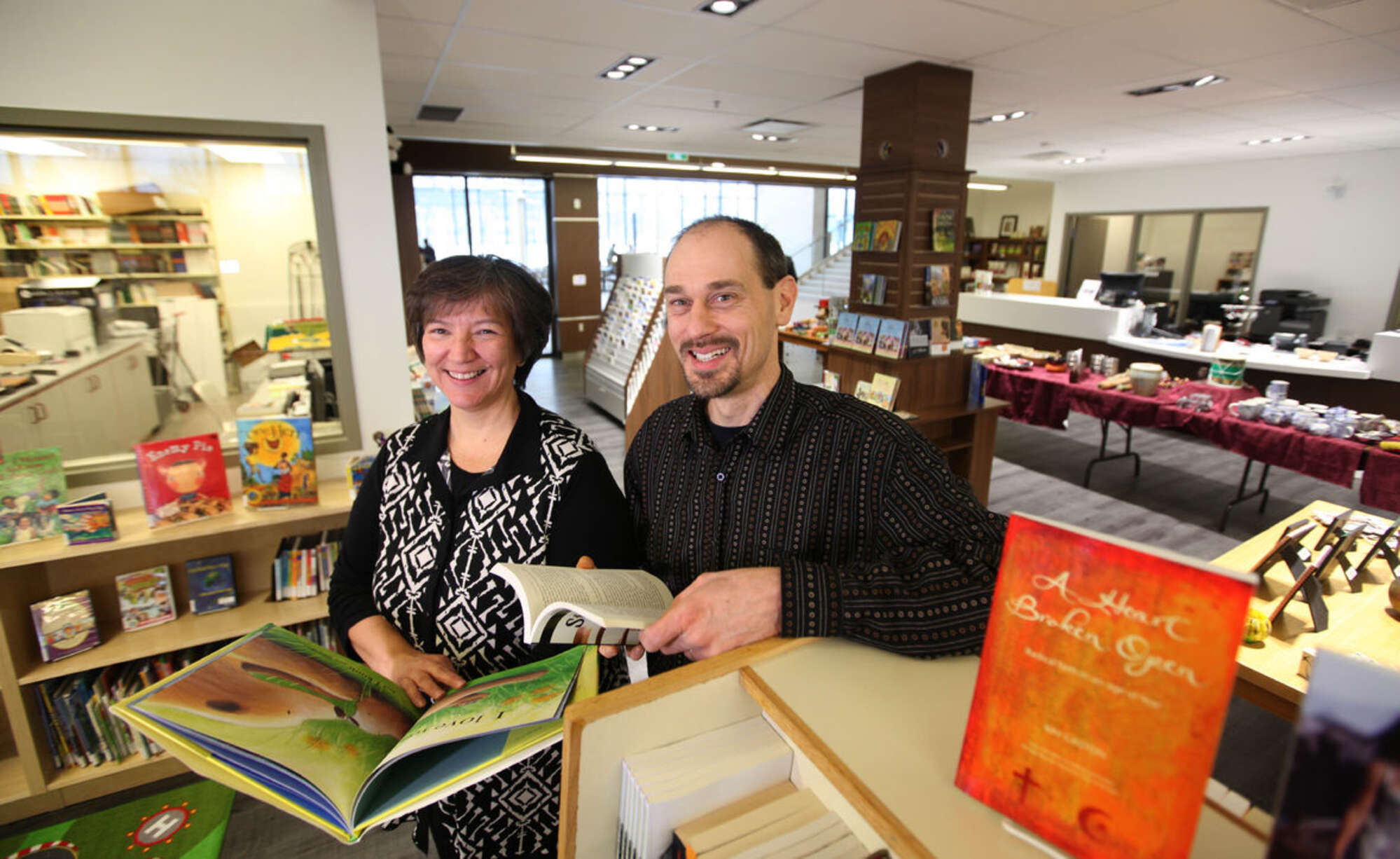 Anita Neufeld and Arlyn Friesen Epp manage CommonWord, which sells and lends books and other materials at Canadian Mennonite University.