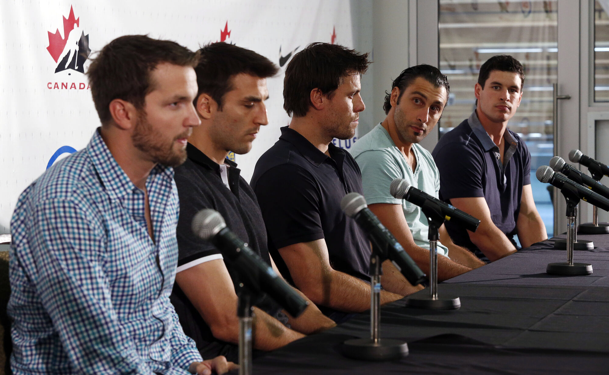 Rick Nash, Patrice Bergeron, Shea Weber, Roberto Luongo and Sidney Crosby address the media at a team orientation camp in Calgary on Sunday.