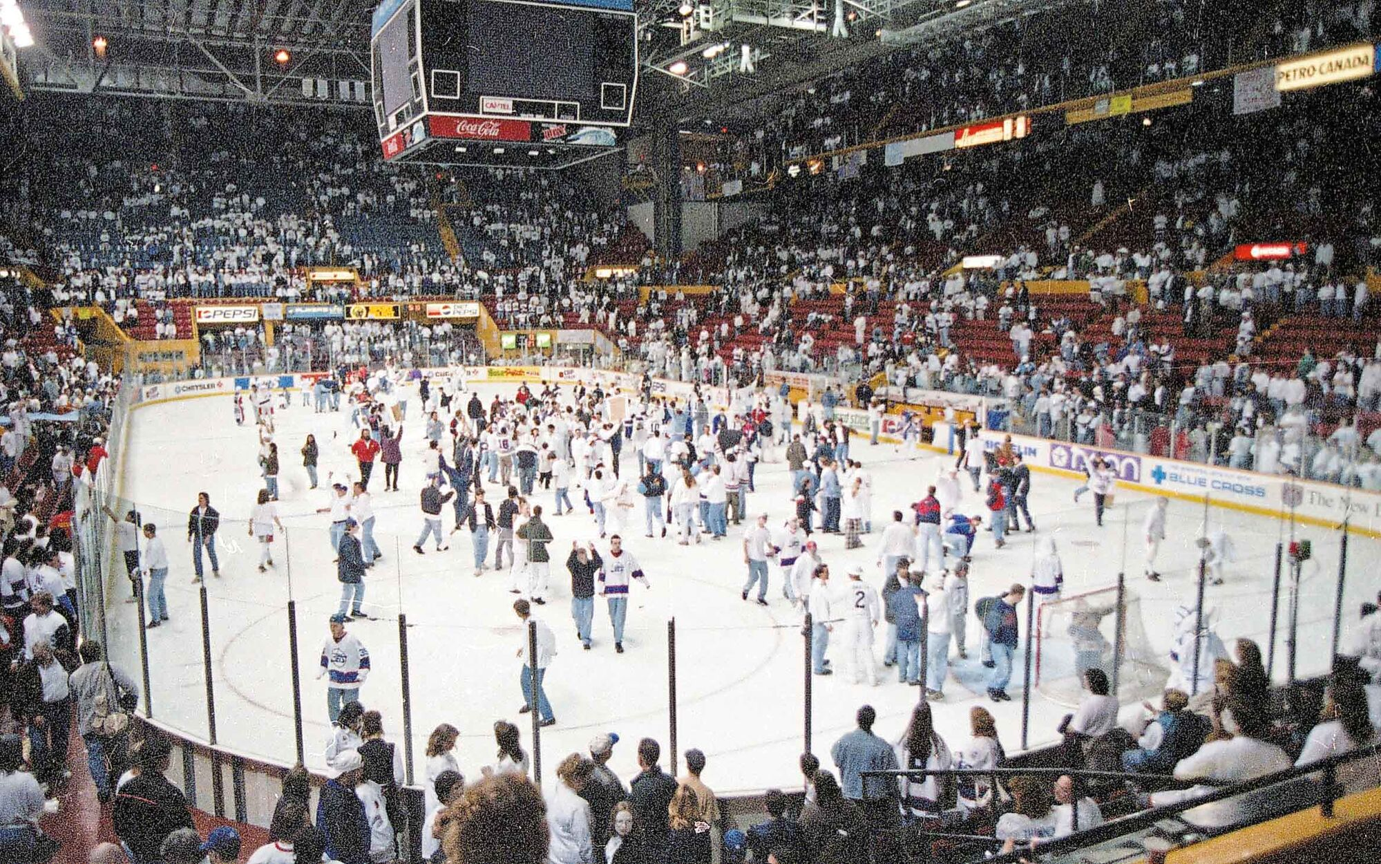 Fans flood the ice after the game.