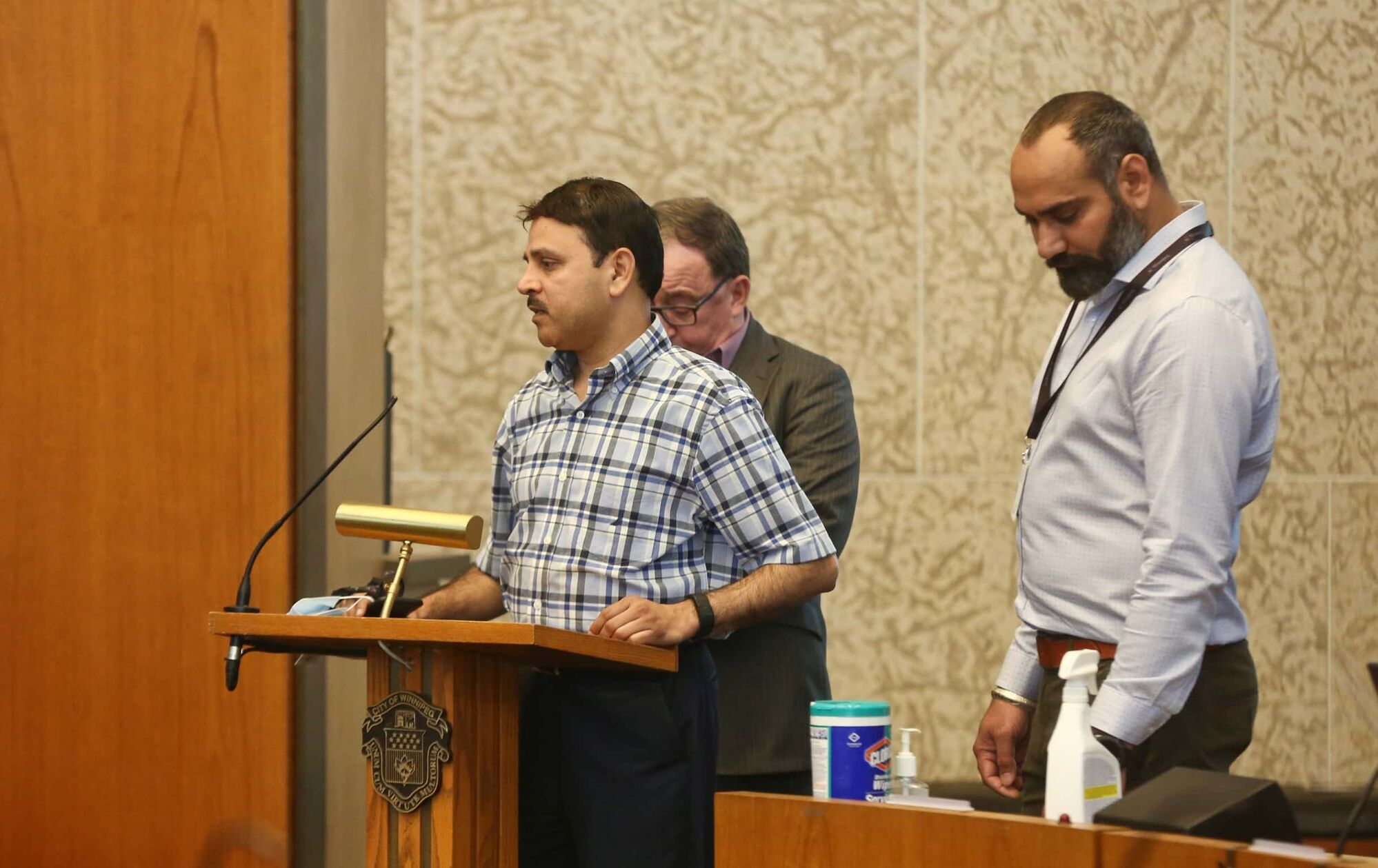(From left) Ram Valluru, GM for Duffy's Taxi and Harjit Chahal, GM for Unicity Taxi, spoke today at the City Hall requesting financial support for the the taxi industry because of the the ramifications from the coronavirus pandemic. (Mike Deal / Winnipeg Free Press)
