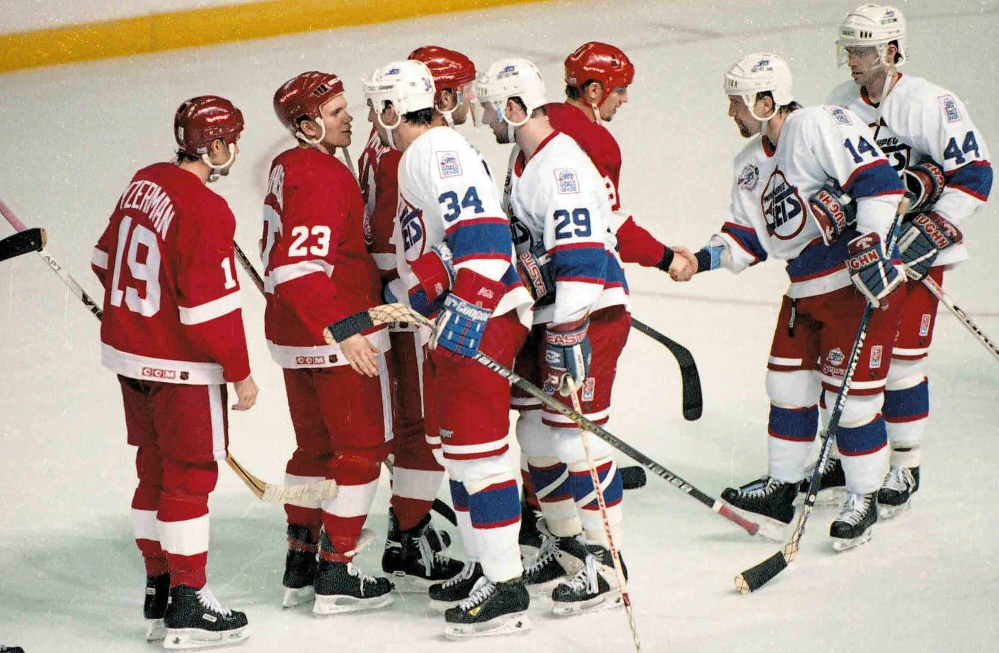 The final handshake between the Jets and Red Wings.