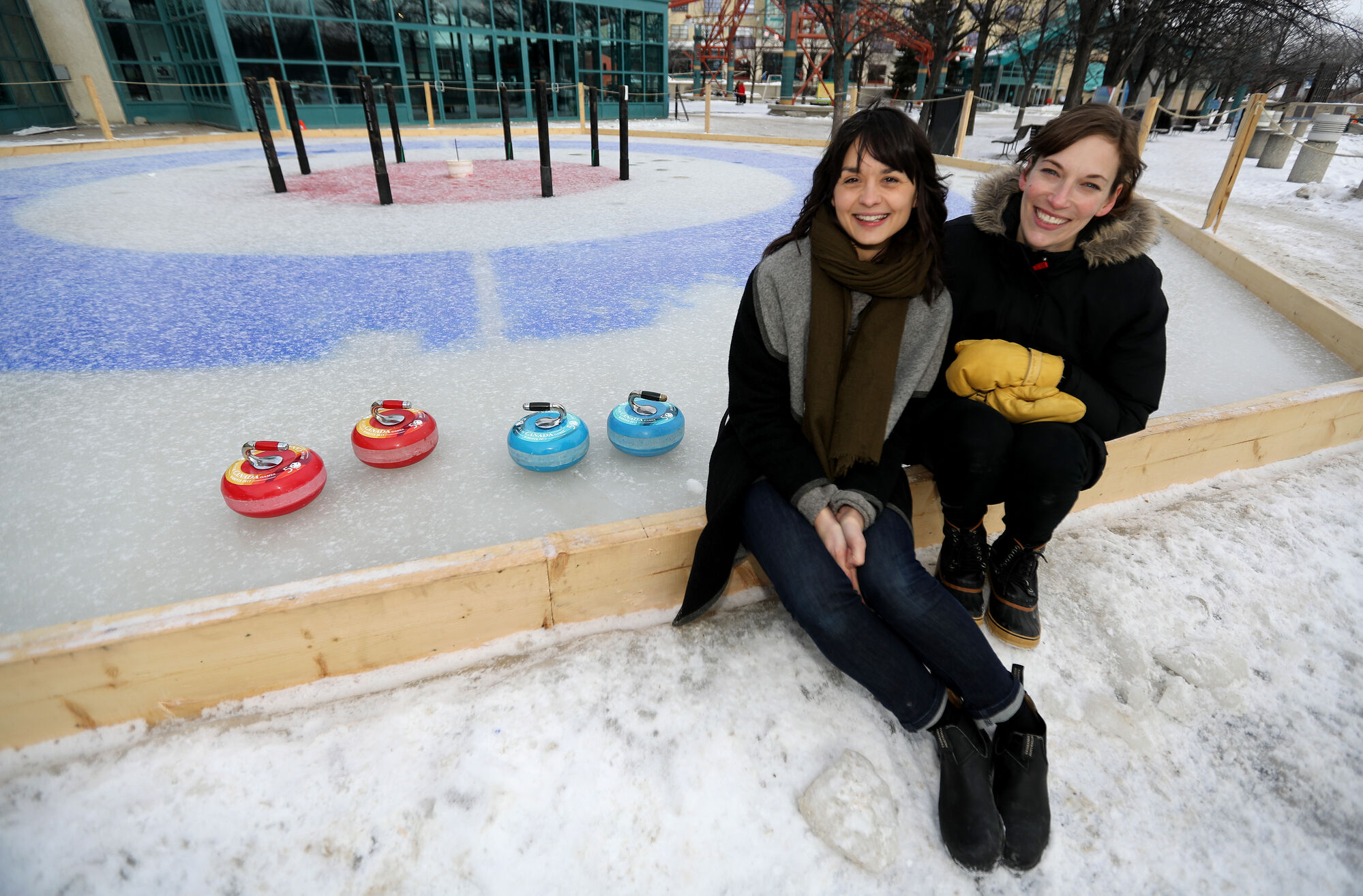 <p>TREVOR HAGAN / WINNIPEG FREE PRESS</p> <p>Leanne Muir, a landscape designer, and Liz Wreford, principal and landscape architect, with Public City Architecture, with their Crokicurl game at The Forks.</p>