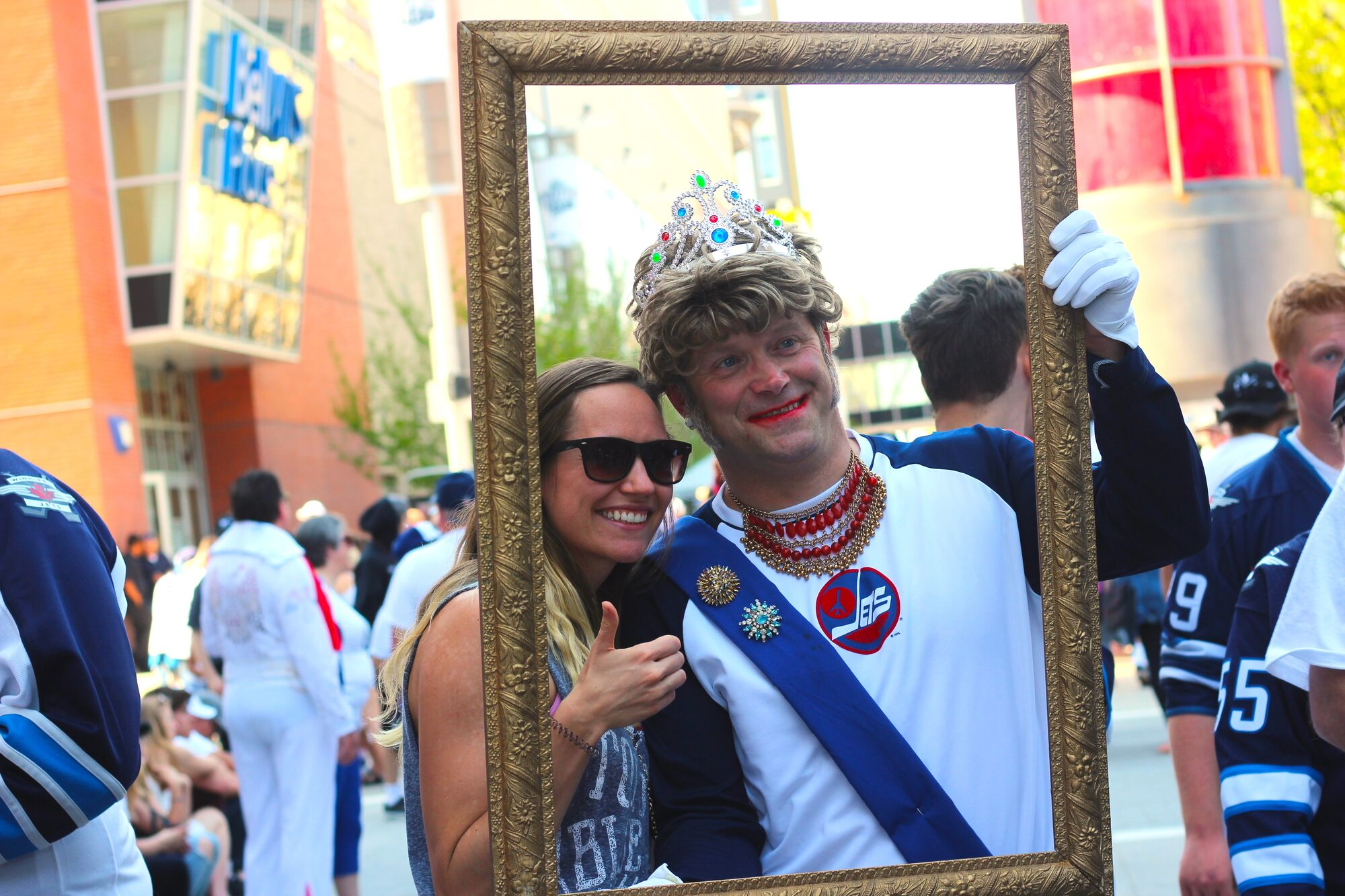 JESSICA BOTELHO-URBANSKI / WINNIPEG FREE PRESS FILES <p />  Mikaela Kroeker poses with Queen Elizabeth II (also known as Cam Scott) during the Jets' Whiteout street party on May 20.