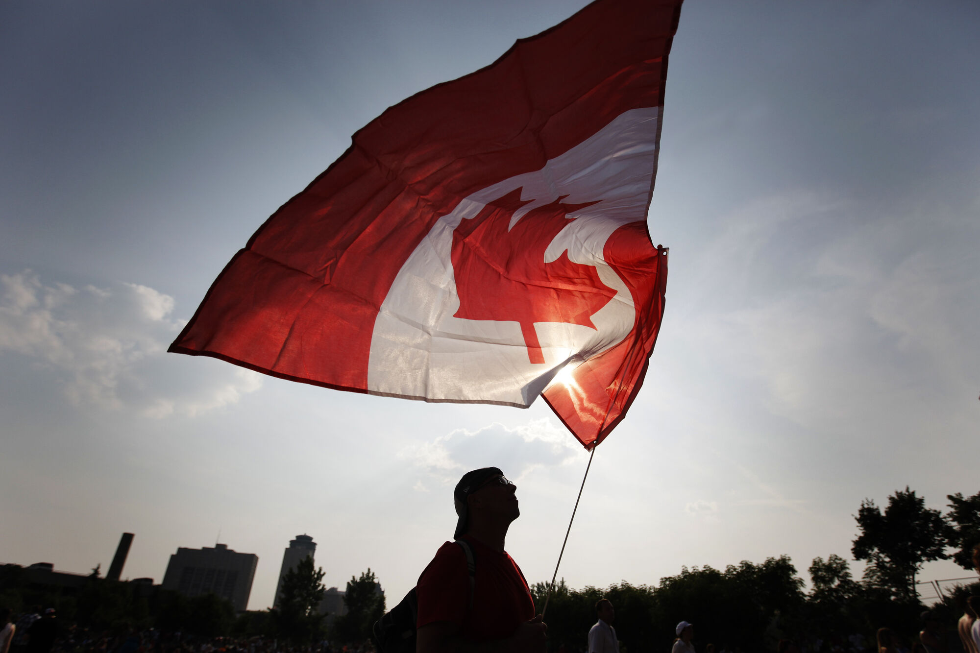 July 1, 2013 - 130701  - Gerry Wert flies his flag high during the Canada Day festivities at The Forks Monday, July 1, 2013. John Woods / Winnipeg Free Press
