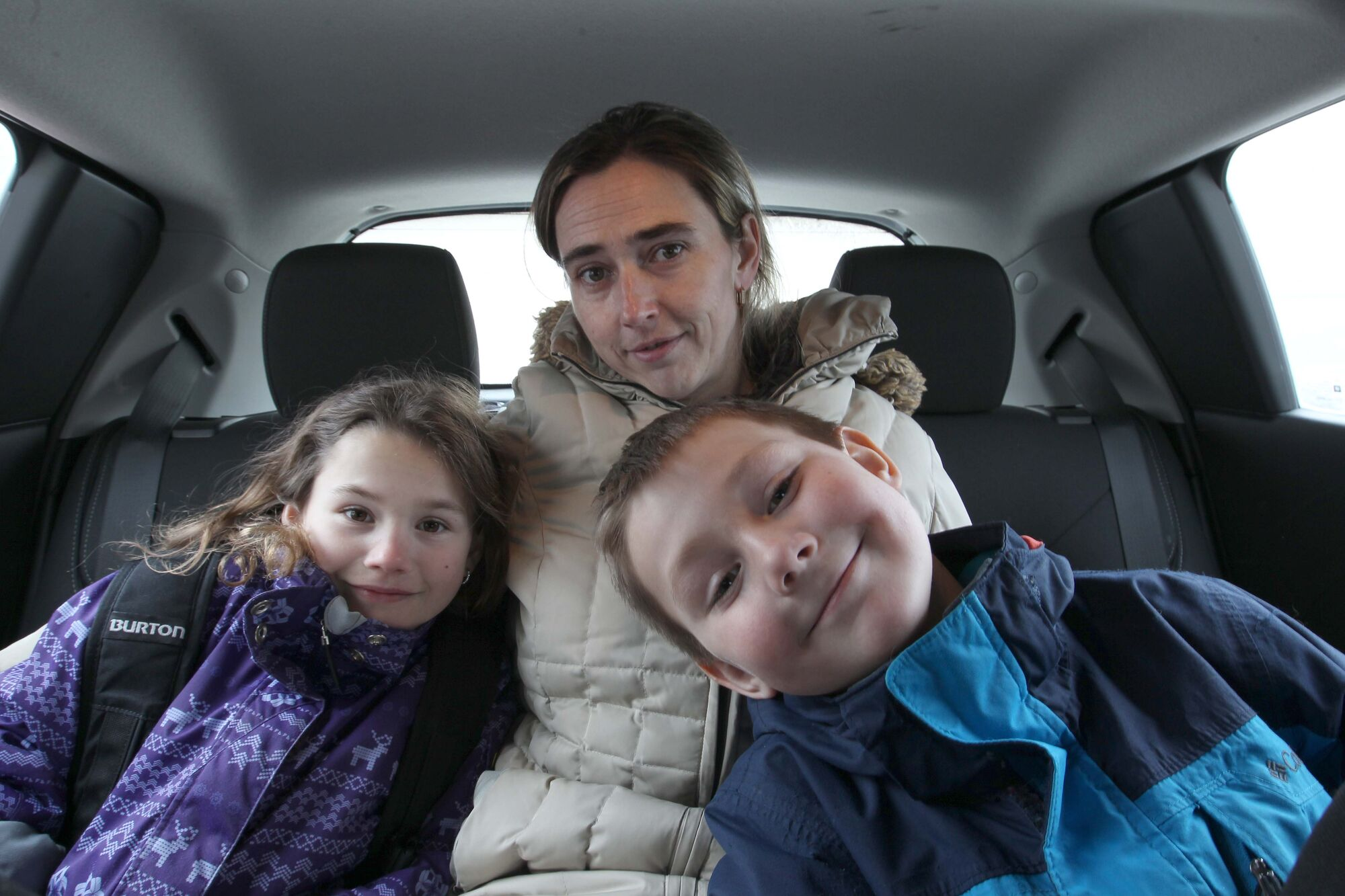 Marta Placzek with her children, Jakub (right) and Justyna, is afraid to return to Poland, where her ex-husband lives.