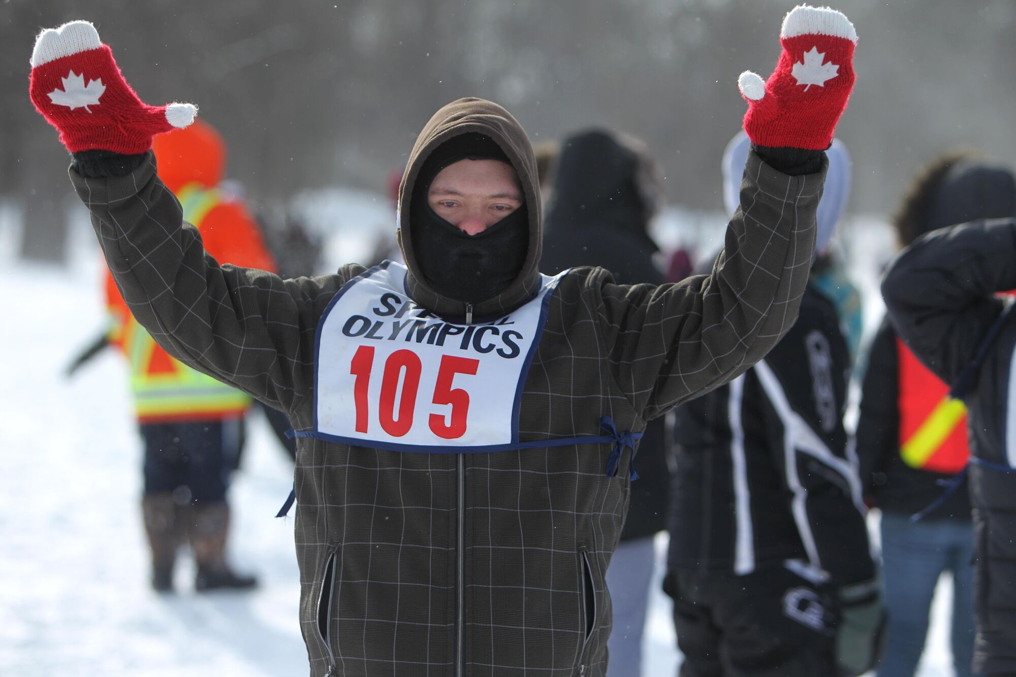 David Cheyne makes his way over the finish line while competing in the 100-metre snowshoeing event at the 2014 Special Olympics Winter Games held at St. John's-Ravesncourt School in February.