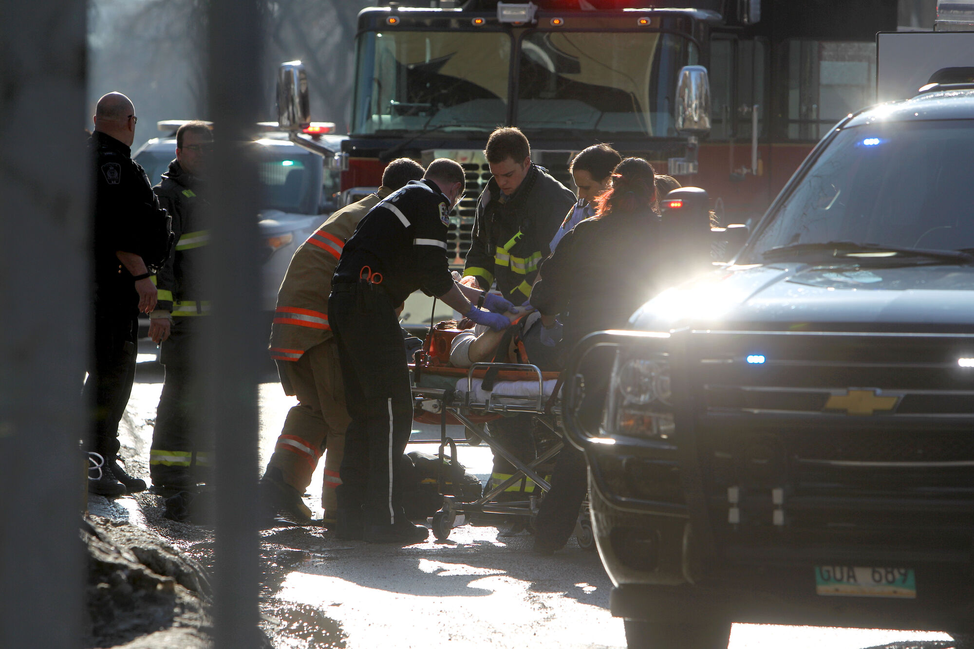 A women is placed on a stretcher after being hit by a car while she was crossing Broadway at Donald Street at about 5 p.m. Saturday afternoon.