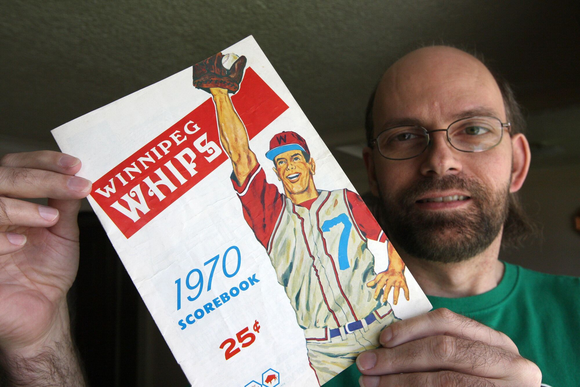 Brian Hrynick with memorabilia from the Whips, a Montreal Expos farm-team that played in Winnipeg for two seasons in the early 1970s.