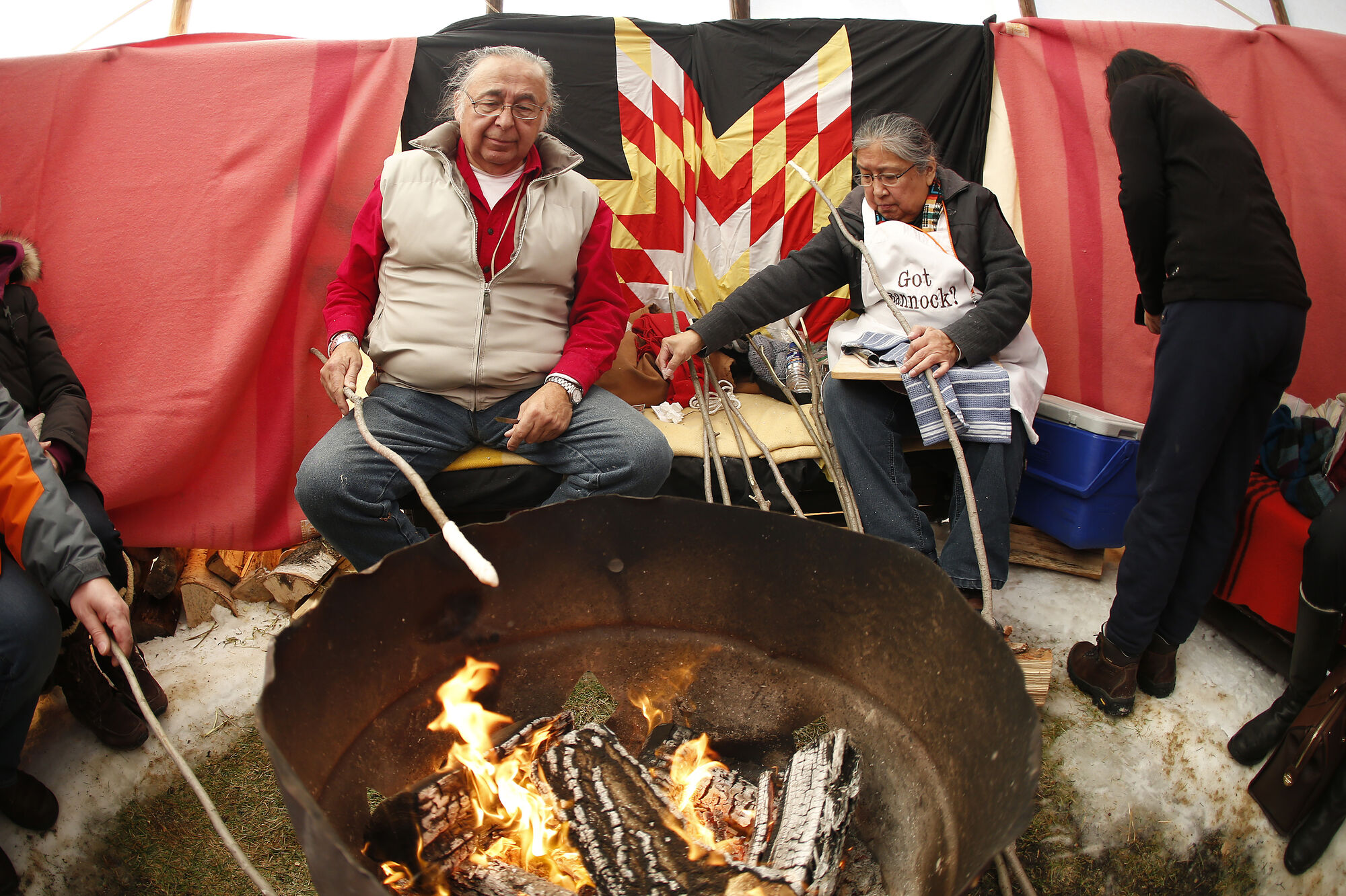 Clarence and Barbara Nepinak cook bannock in a teepee at The Forks on Jan. 15, 2017. (John Woods / Winnipeg Free Press files)