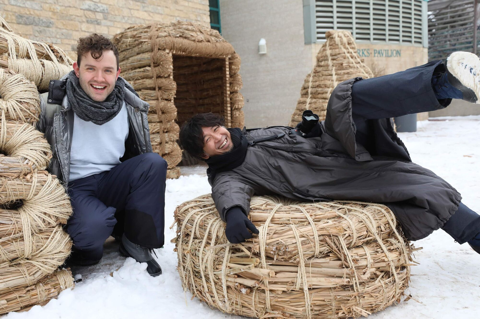 Team members Masato Ashida (right) and Adrian Steckeweh pose for photos in their version of a warming hut at the Forks Friday. The architectural team from Japan showcased what they call Forrest Village for their 2020 entry, one of  the 3 winners in the Forks warming hut competition. (Ruth Bonneville / WInnipeg Free Press)