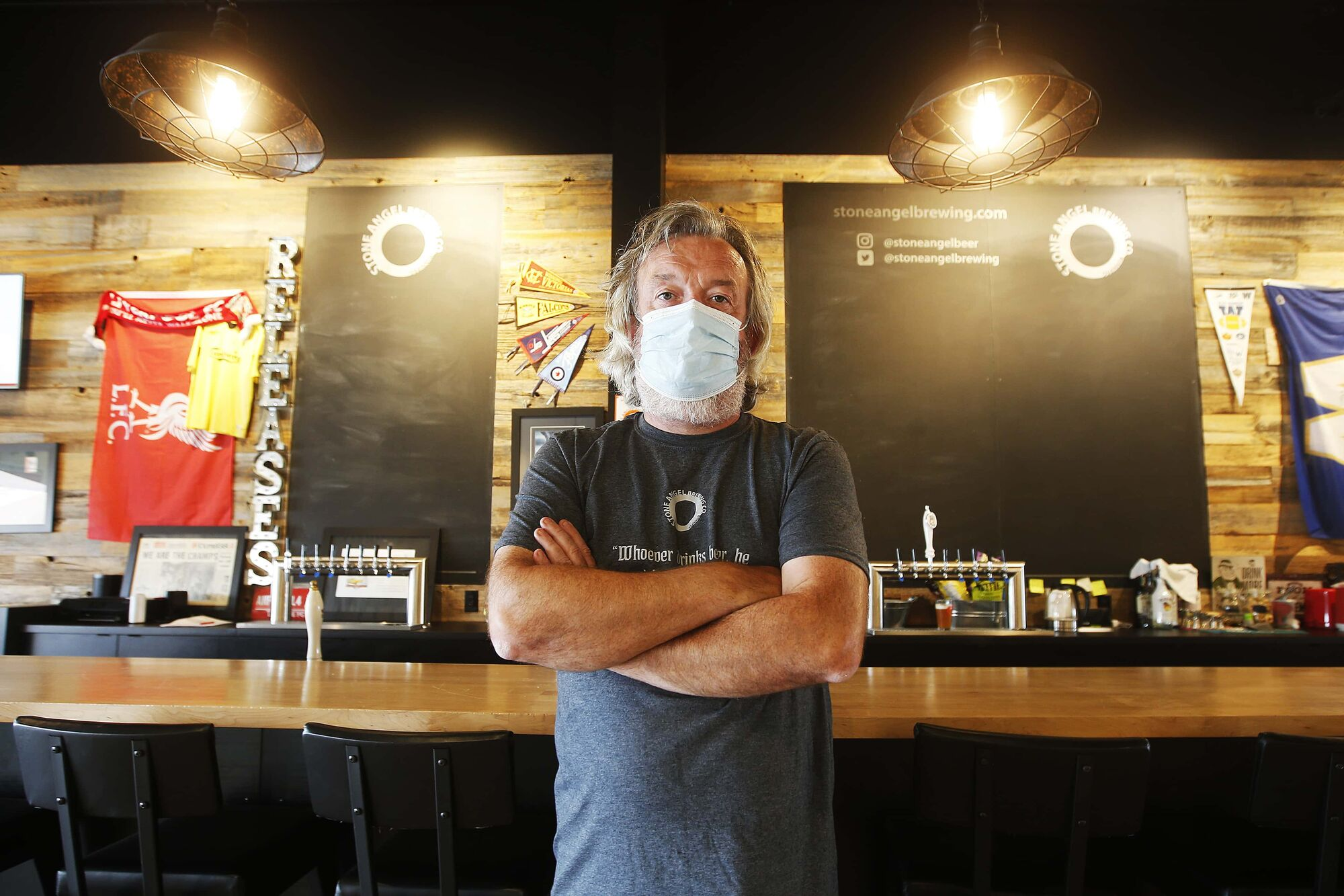 Co-owner Paul Clerkin says Stone Angel Brewing is keeping the mask and vaccination status checks until the foreseeable future. (John Woods / Winnipeg Free Press)
