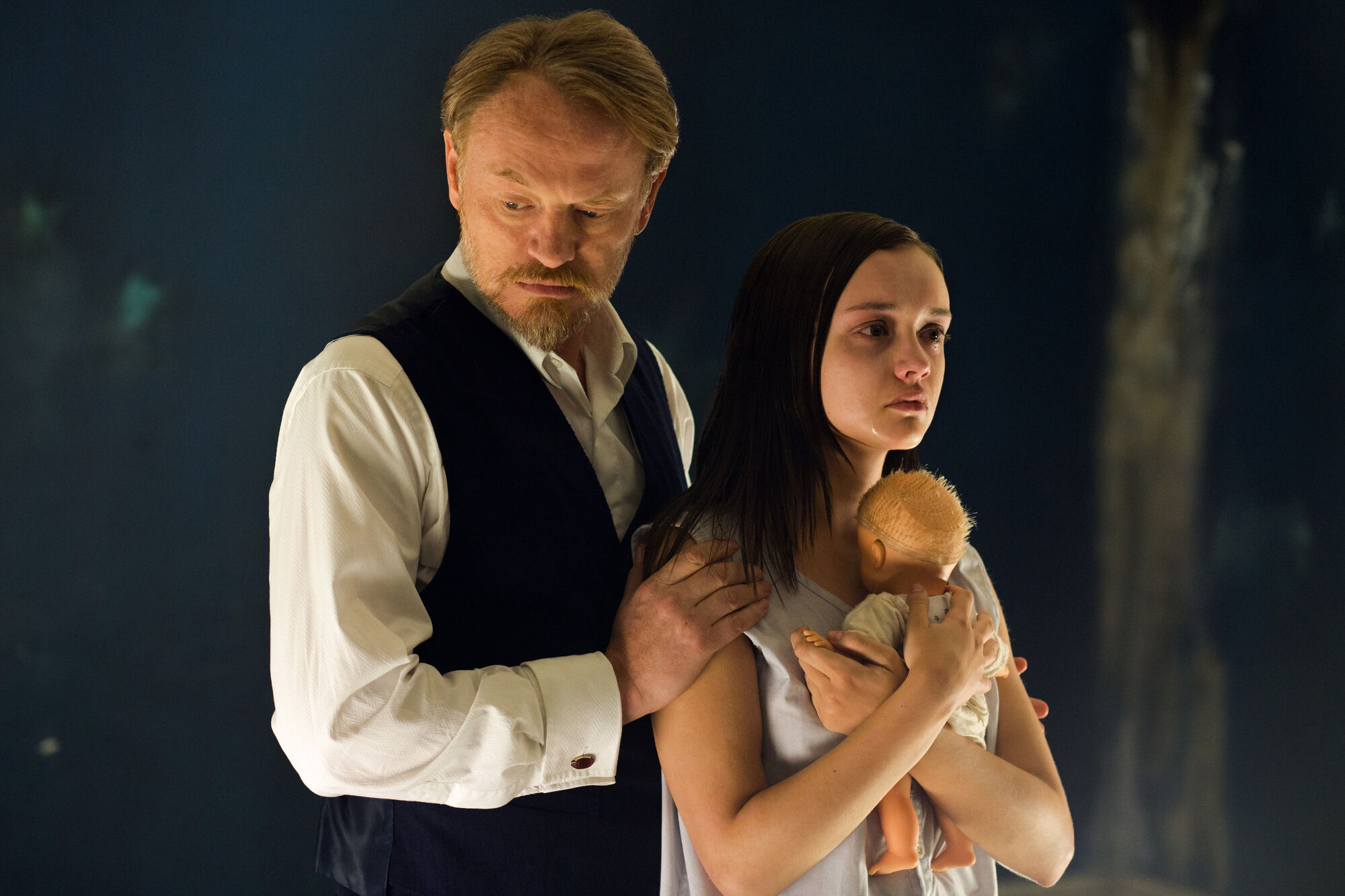 Jared Harris, left, Olivia Cooke and the requisite creepy doll.