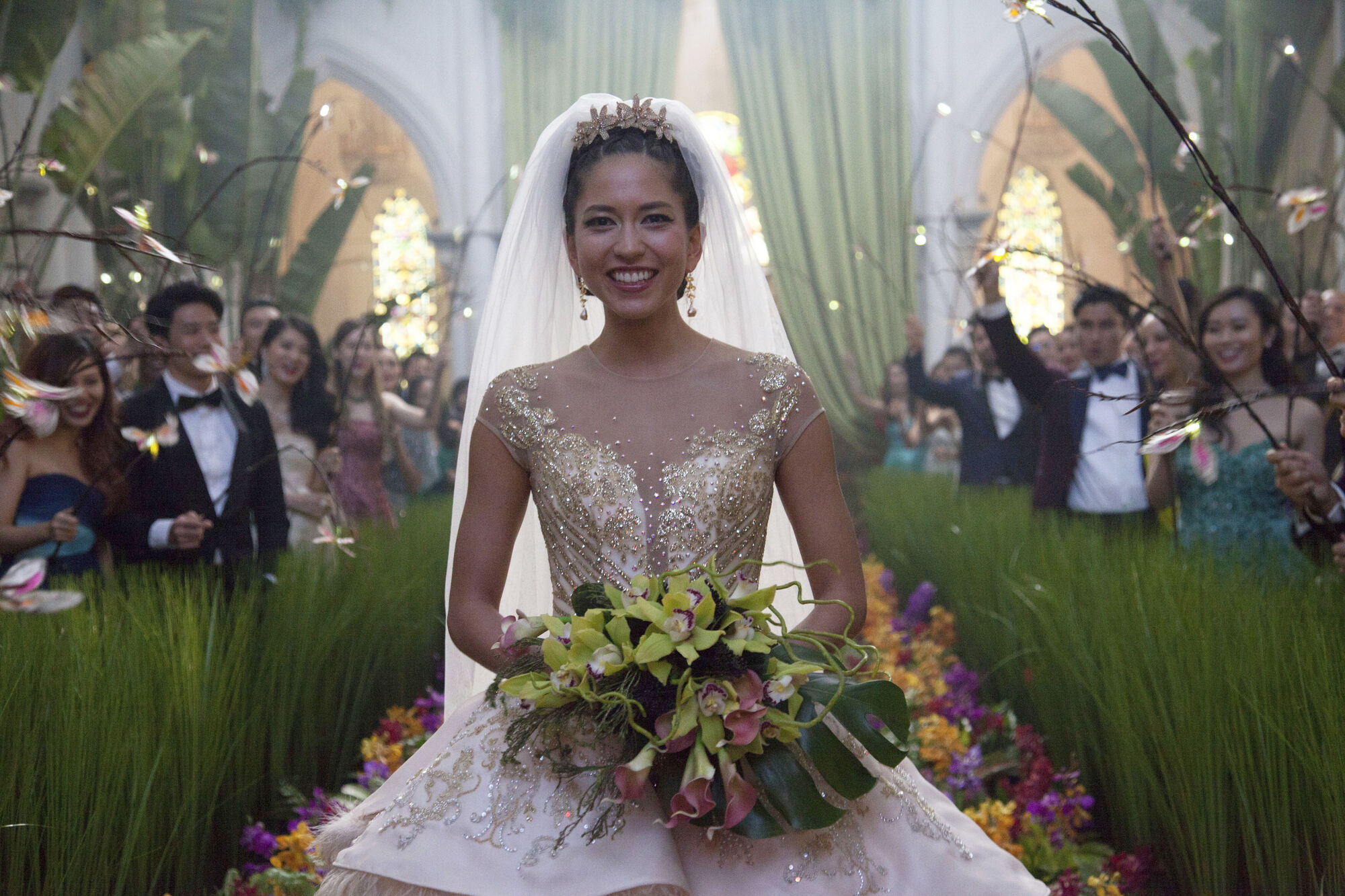 "This image released by Warner Bros. Entertainment shows Sonoya Mizuno in a scene from the film ""Crazy Rich Asians."" (Sanja Bucko/Warner Bros. Entertainment via AP)"