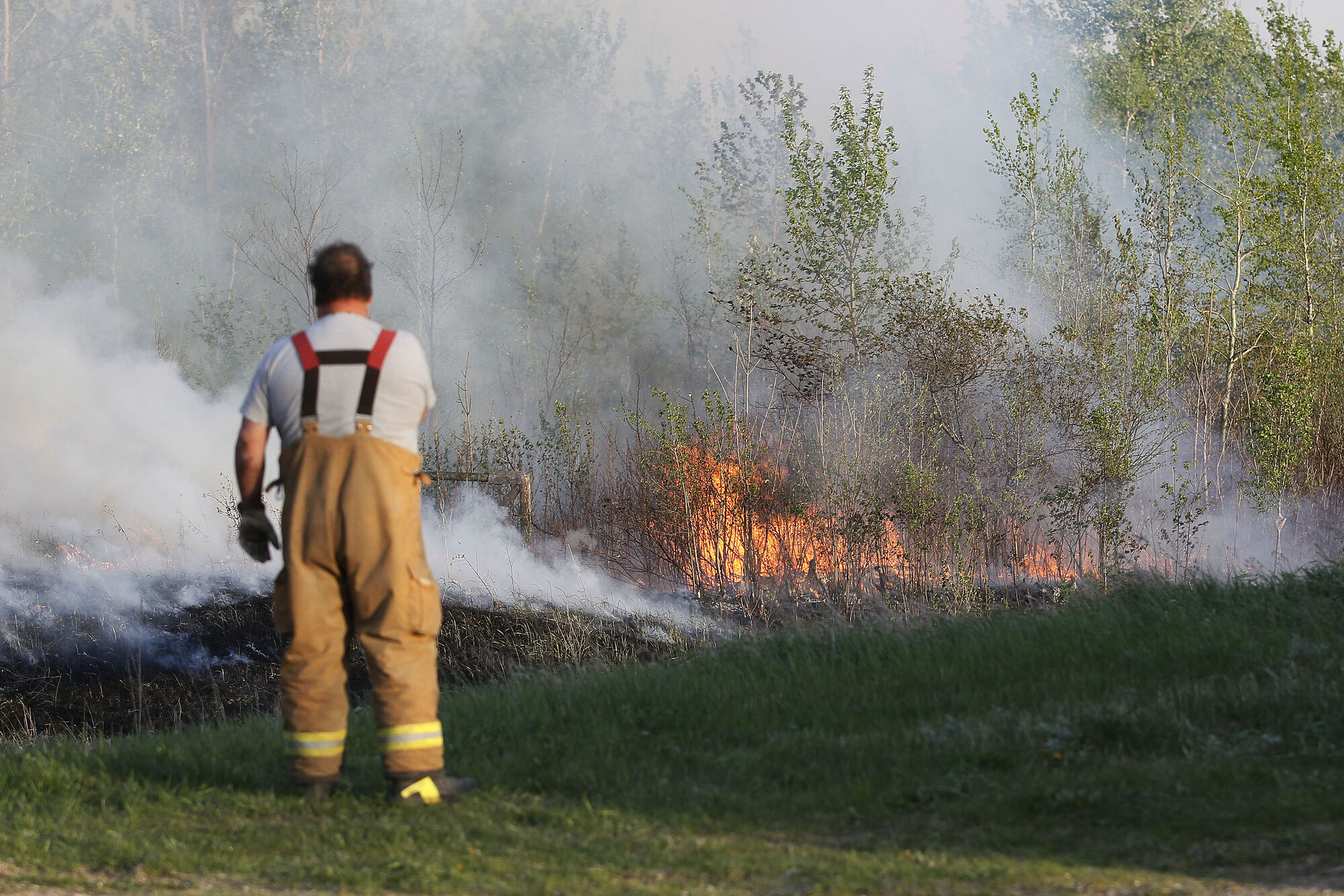 Firefighters from three rural municipalities have been working for two days on wildfires fanned by strong wind in the RM of Piney.