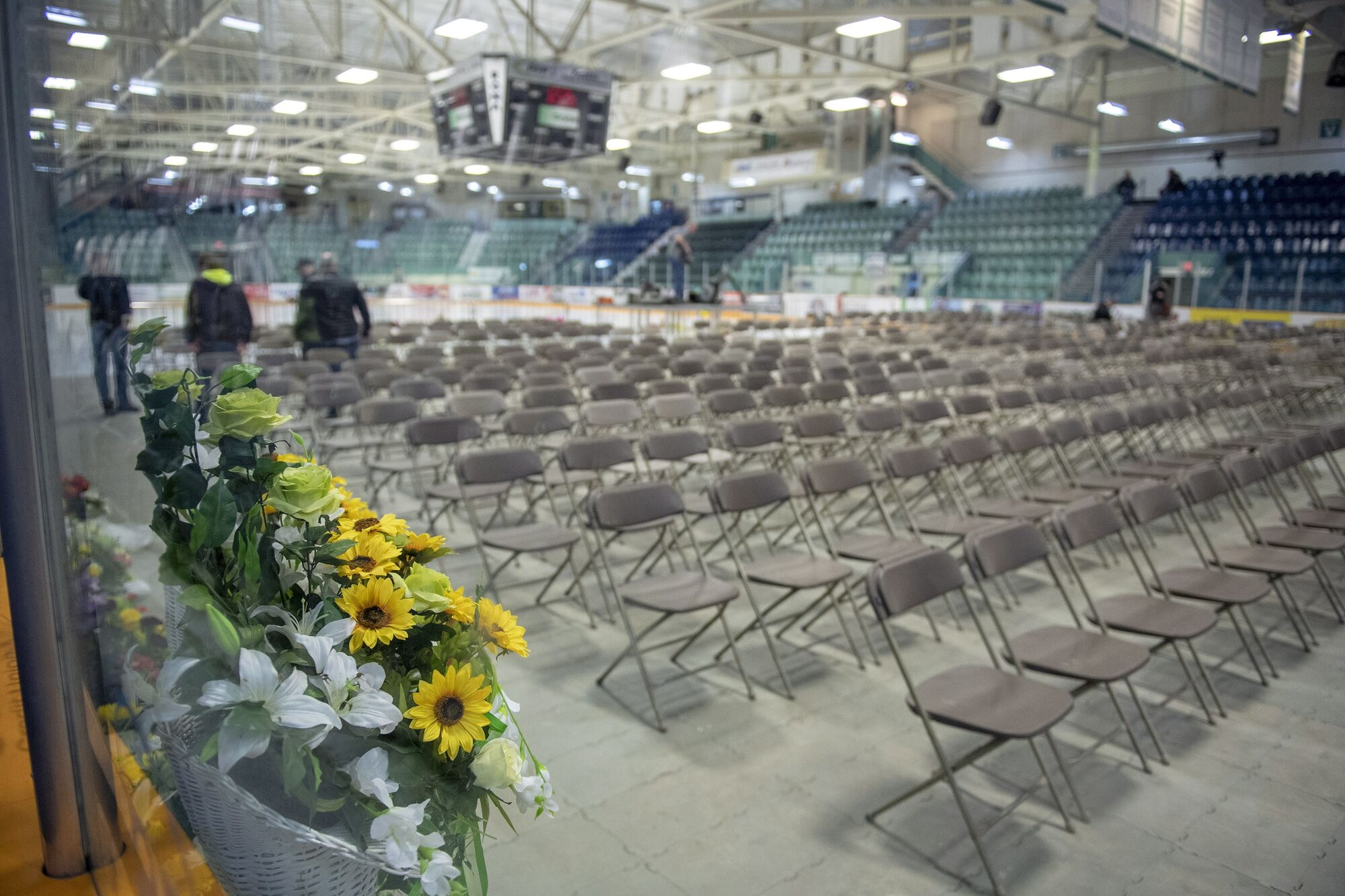 Organizers prepare the Elgar Petersen Arena for a vigil tonight in Humboldt, Sask. A charter bus carrying the town's Broncos hockey team was involved in a collision with a semi-truck Friday, killing 15 people and seriously injuring more than a dozen others.