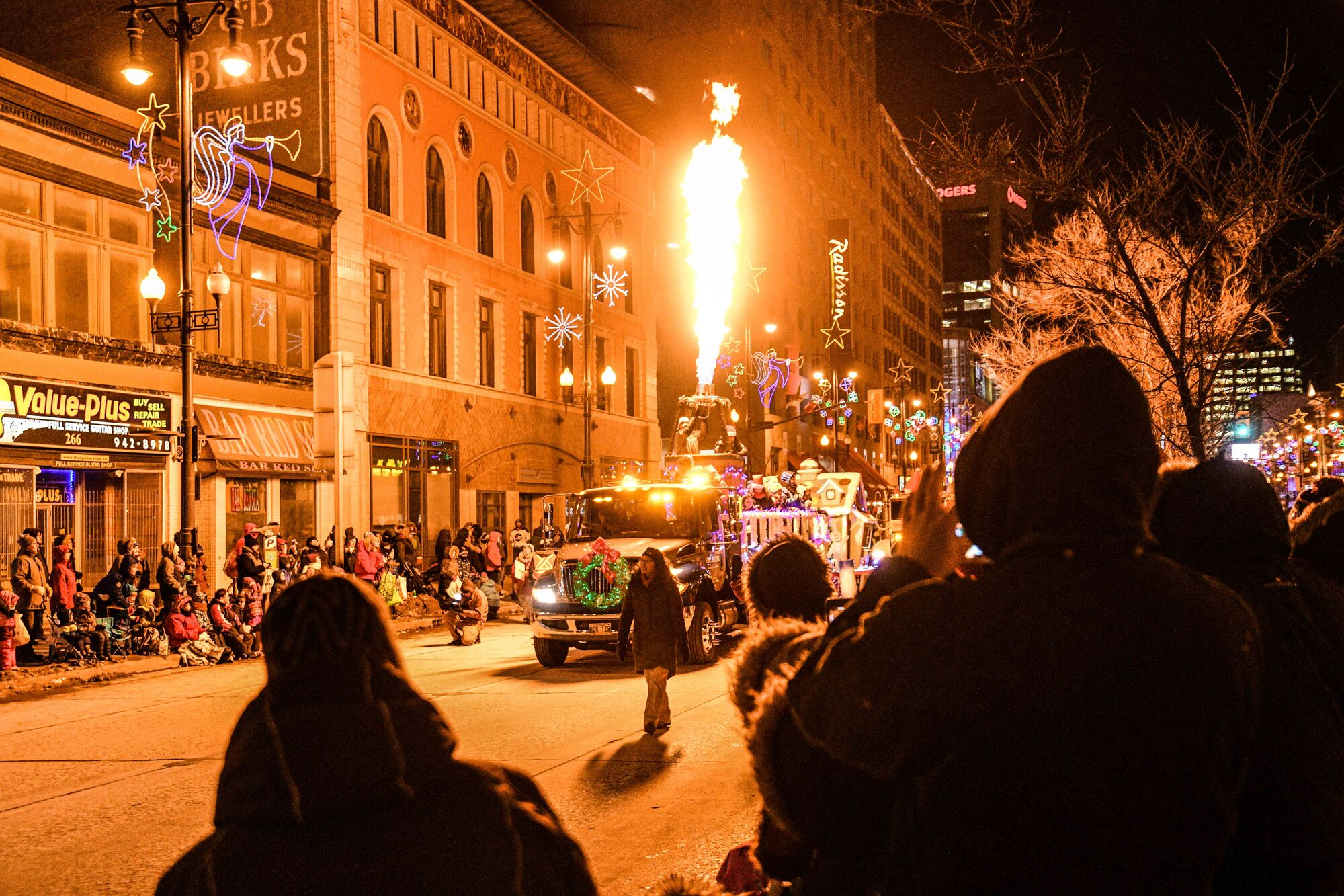 The Streets are alive with Christmas cheer for last year's Santa Clause Parade Nov. 18.