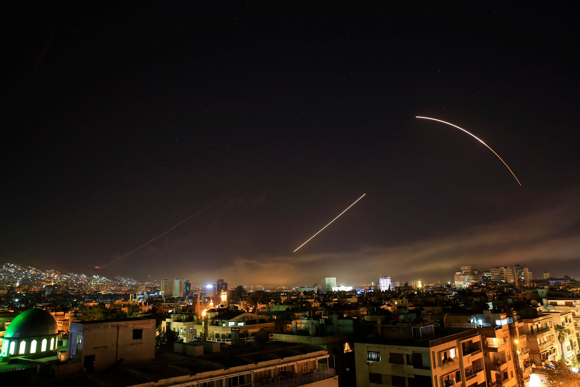 THE ASSOCIATED PRESS  In this Saturday, April 14, 2018 file photo, missiles streak across the Damascus skyline as the U.S. launches an attack on Syria targeting different parts of the capital.