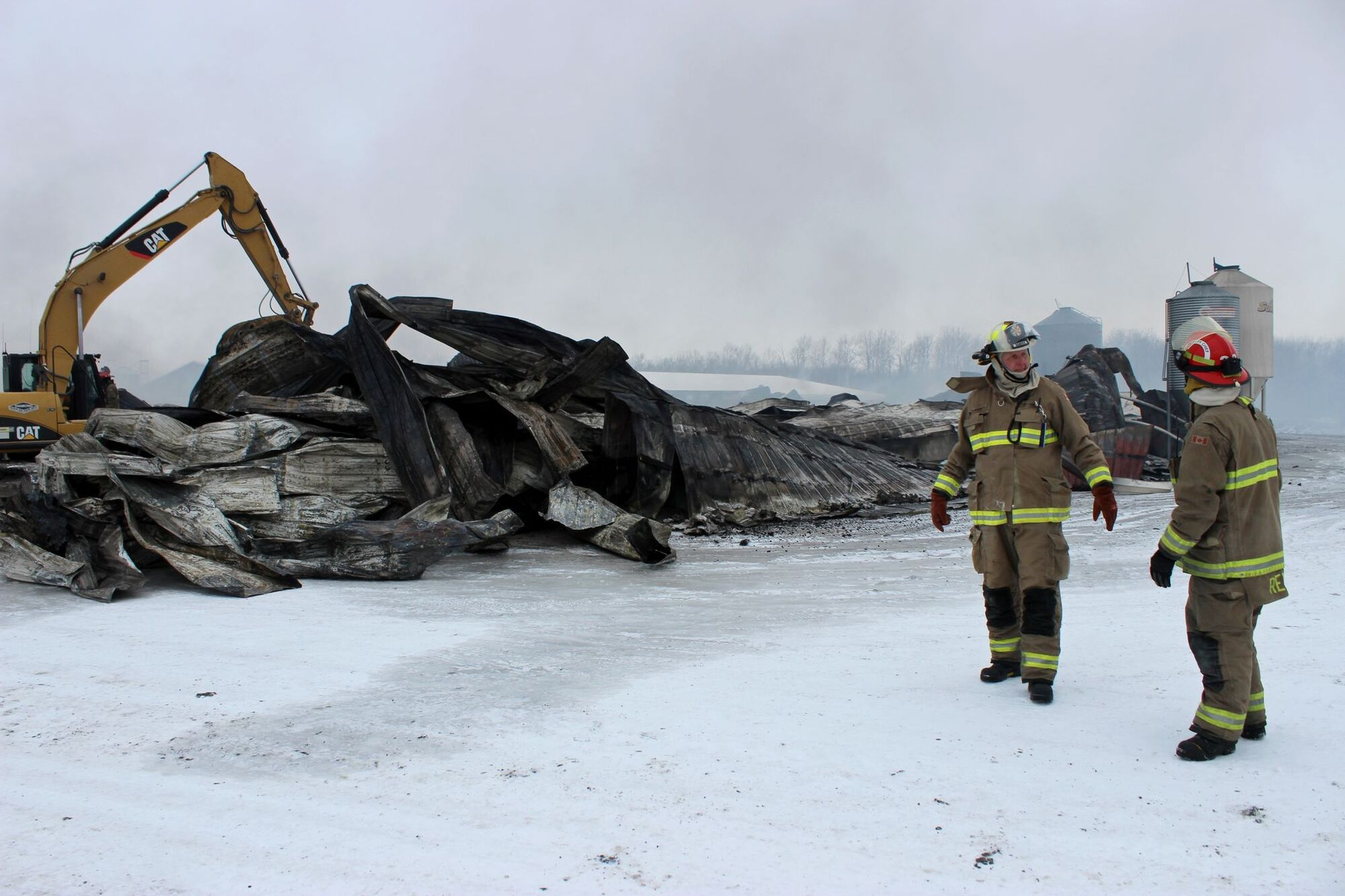 Hanover fire chief Paul Wiebe remains on the scene of a barn fire north of Pansy which killed 7,500 sows and weanlings on Friday morning.