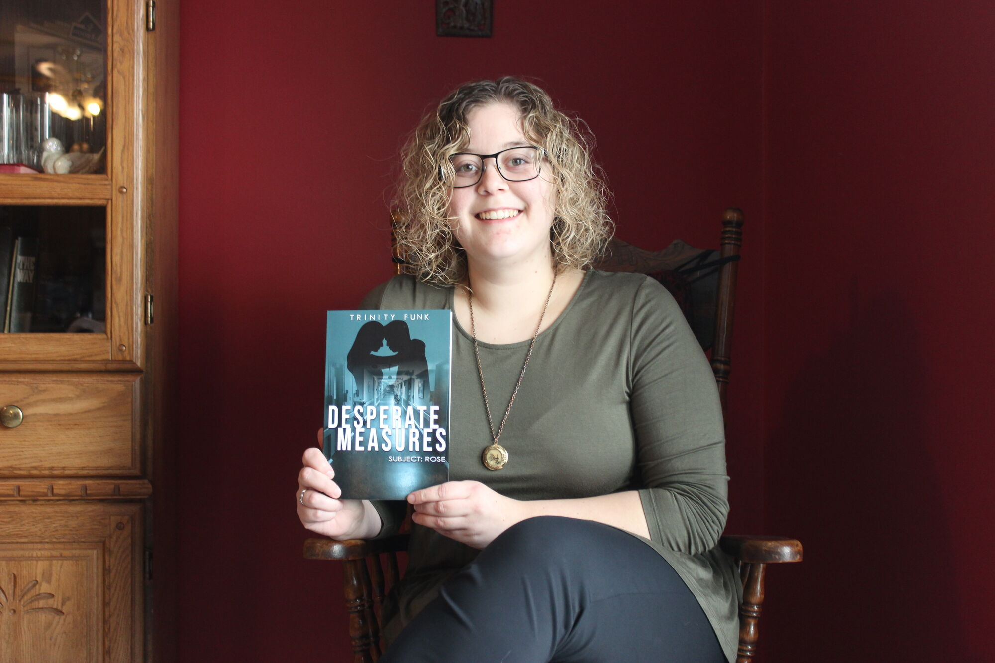 Blumenort author Trinity Funk holds a copy of the self-published young adult novel Desperate Measures: Subject: Rose. Funk, a University of Winnipeg education student, is promoting her first novel online and by word-of-mouth.
