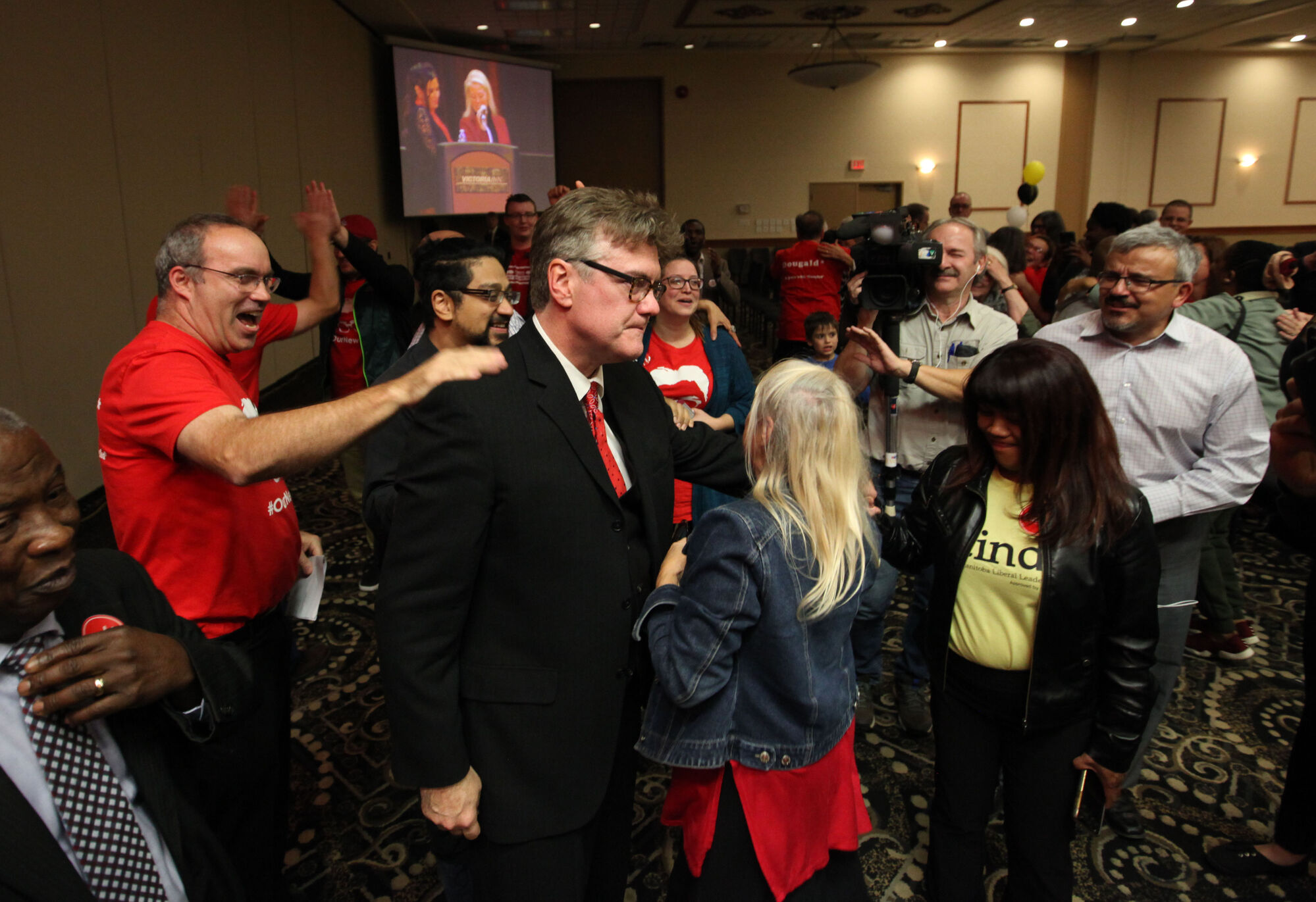 RUTH BONNEVILLE / WINNIPEG FREE PRESS Liberal Leader Dougald Lamont needs to seek a seat in the legislature.  Dugald Lamont is hugged by supporters after being announced the winner of the Manitoba Liberal leadership race at Victoria Inn Saturday.     Oct 21,, 2017