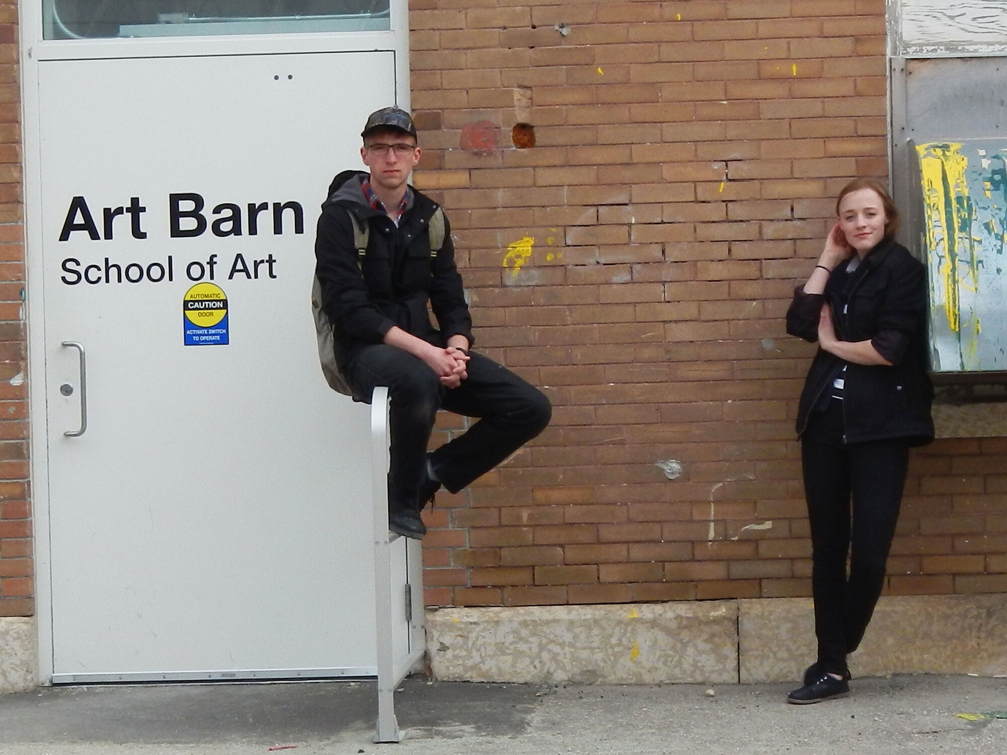 U of M fine arts students John Patterson, left, and Shaylyn Plett.