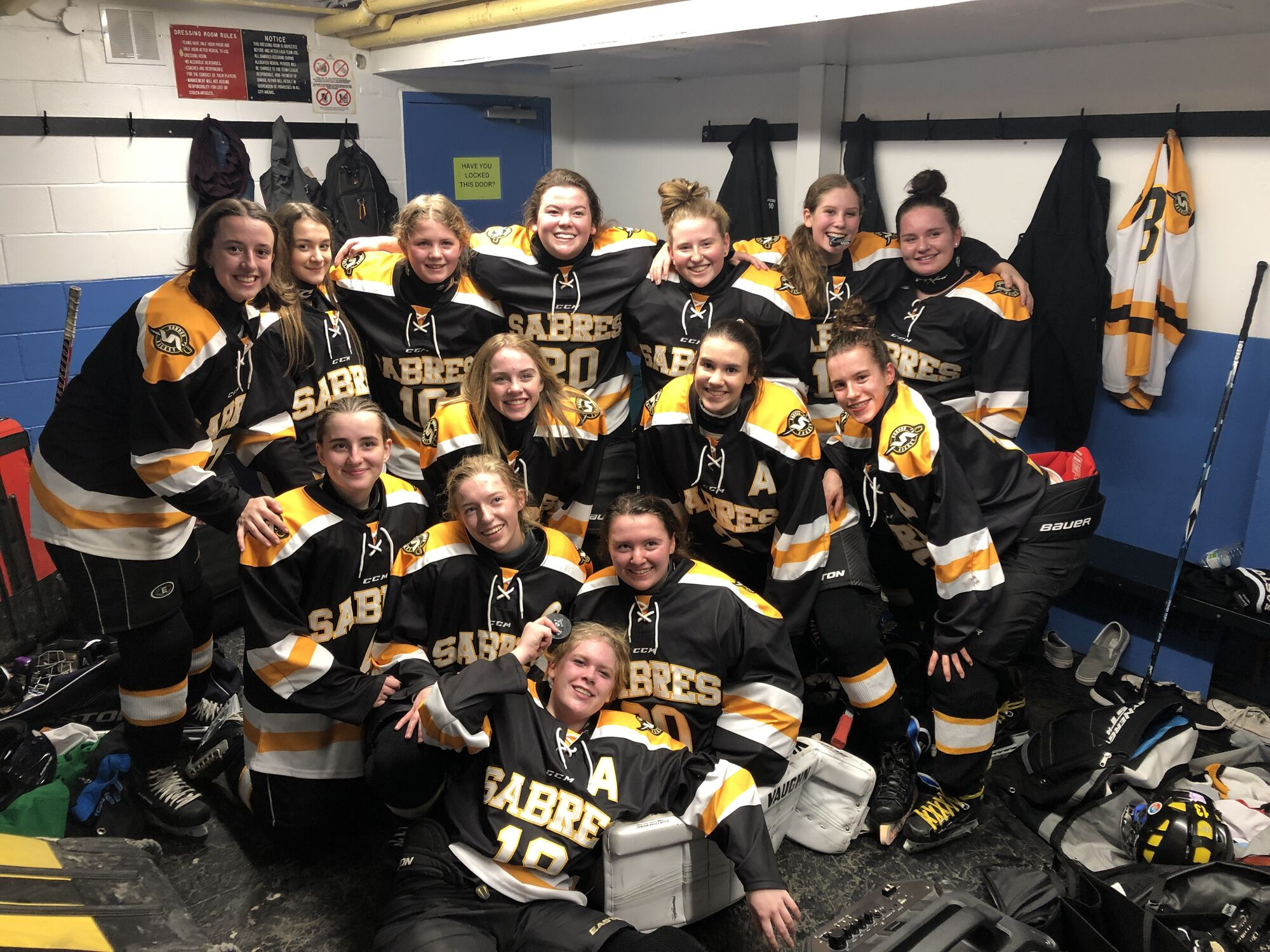 The SRSS Sabres, pictured here celebrating Monday in Winnipeg following their historic first-ever win, 2-0 over Kildonan East, did it again Wednesday in Steinbach, defeating those same Reivers, 2-1 in a marathon shootout.