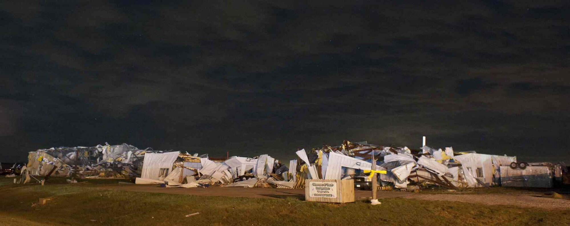 Several buildings sit damaged Saturday in Wayne, Neb. after witnesses said tornadoes swept through the southeast corner of the community. Some of the greatest damage from tornadoes seemed to be in Wayne, Neb., a town of 9,600 where witnesses said at least four homes were destroyed.   (Dave Weaver / The Associated press)