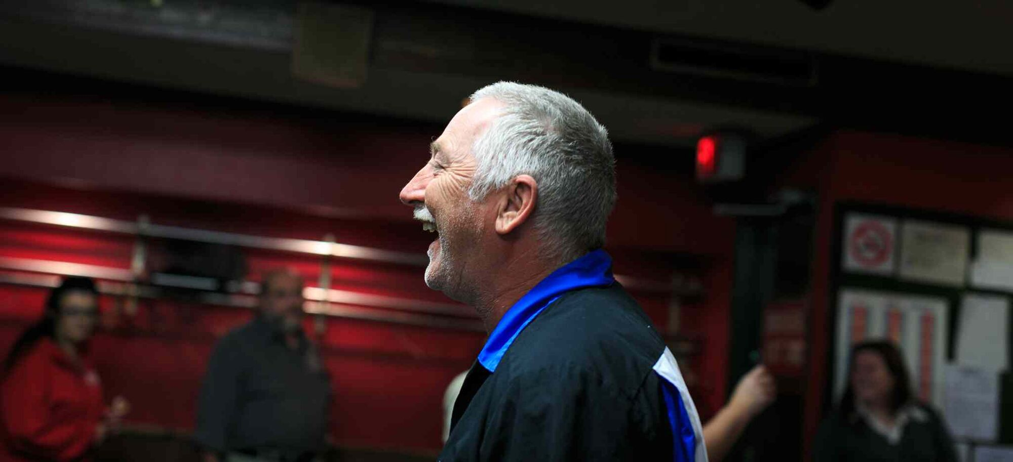 Dan Cady laughs during a game of darts at the St. James Legion off Portage. (Melissa Tait / Winnipeg Free Press)