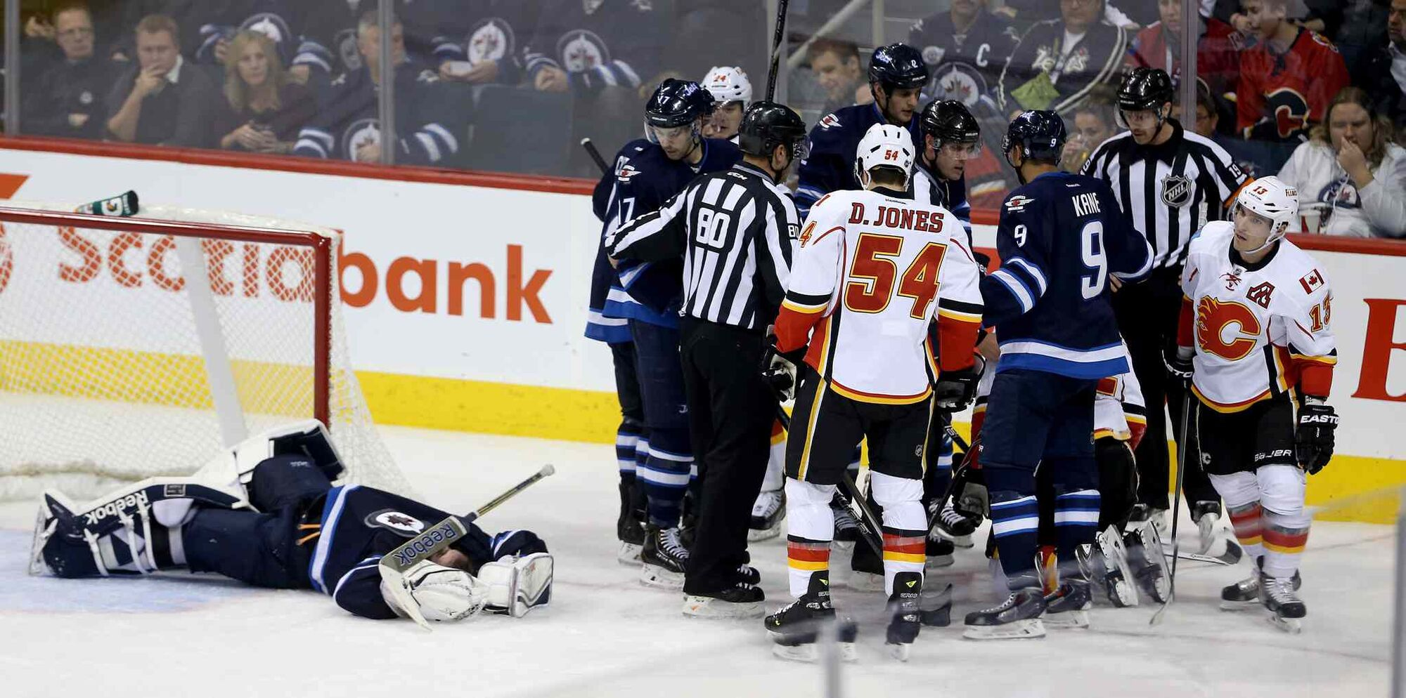 Winnipeg Jets' goaltender Al Montoya (35) lays on the ice after being crushed by Calgary Flames' Lee Stempniak (22) during third period NHL hockey action in Winnipeg Monday, Nov. 18, 2013.