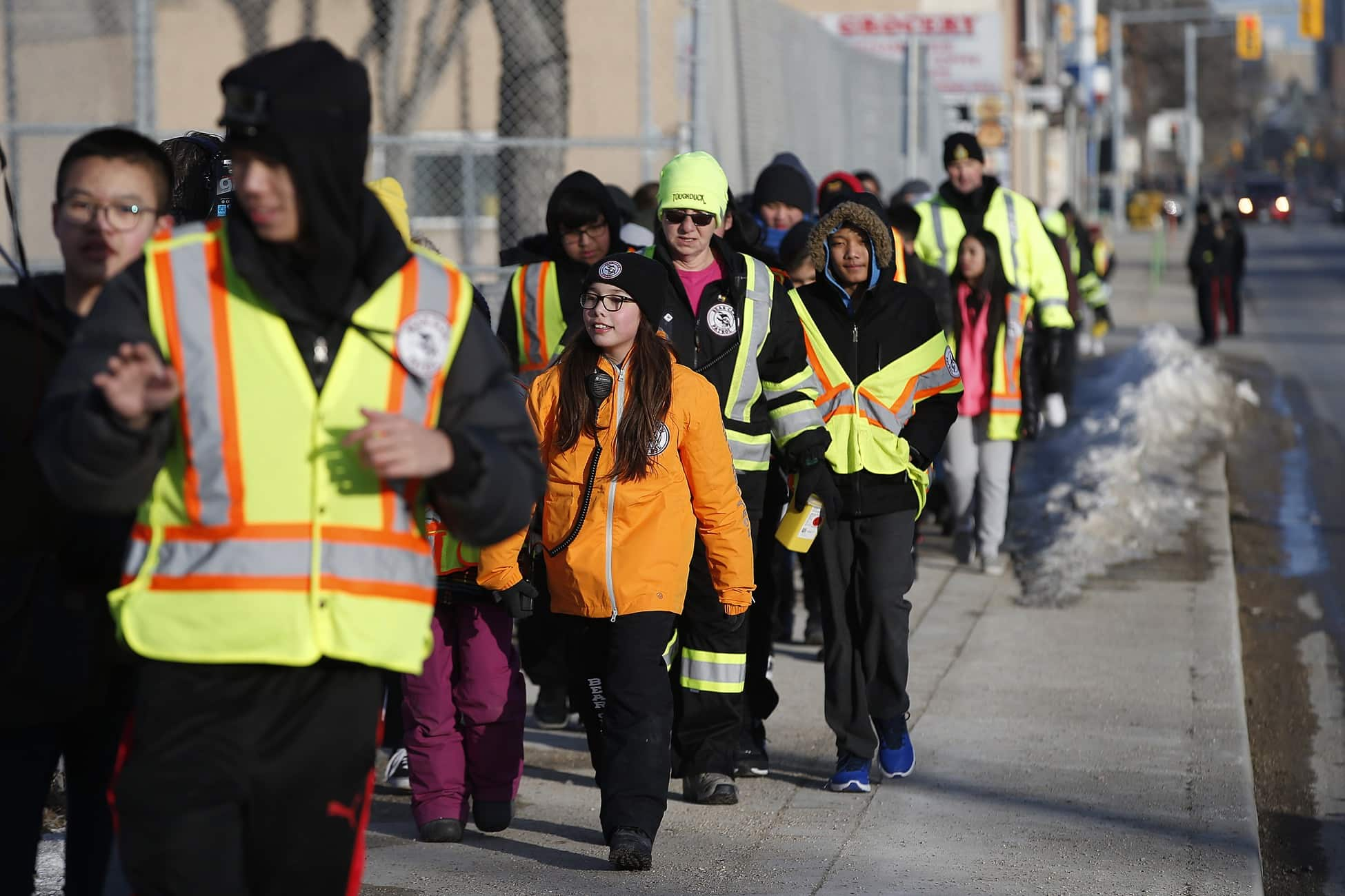 Dozens of students donned neon vests to patrol the West End streets surrounding General Wolfe School after the afternoon bell rang, marking the first time the Indigenous-led community watch group has partnered with schools. (John Woods / Winnipeg Free Press)
