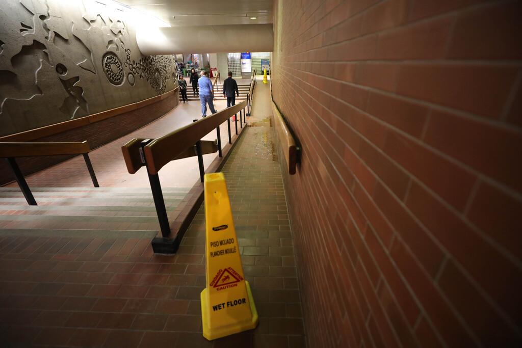 Water accumulated in various parts of the underground concourse at Portage and Main in March. (Ruth Bonneville / Winnipeg Free Press files)