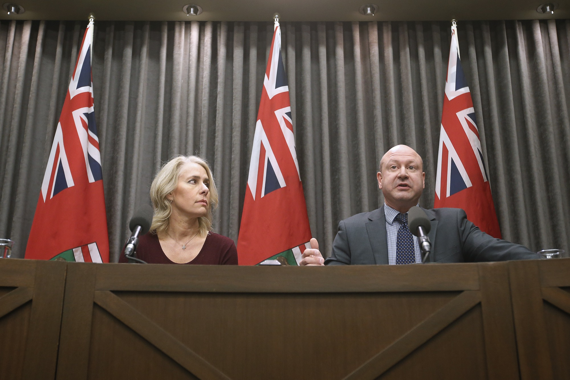 Lanette Siragusa, chief nursing officer (left) and Dr. Brent Roussin, chief public health officer giving an update on the coronavirus in March.  (John Woods / Winnipeg Free Press files)
