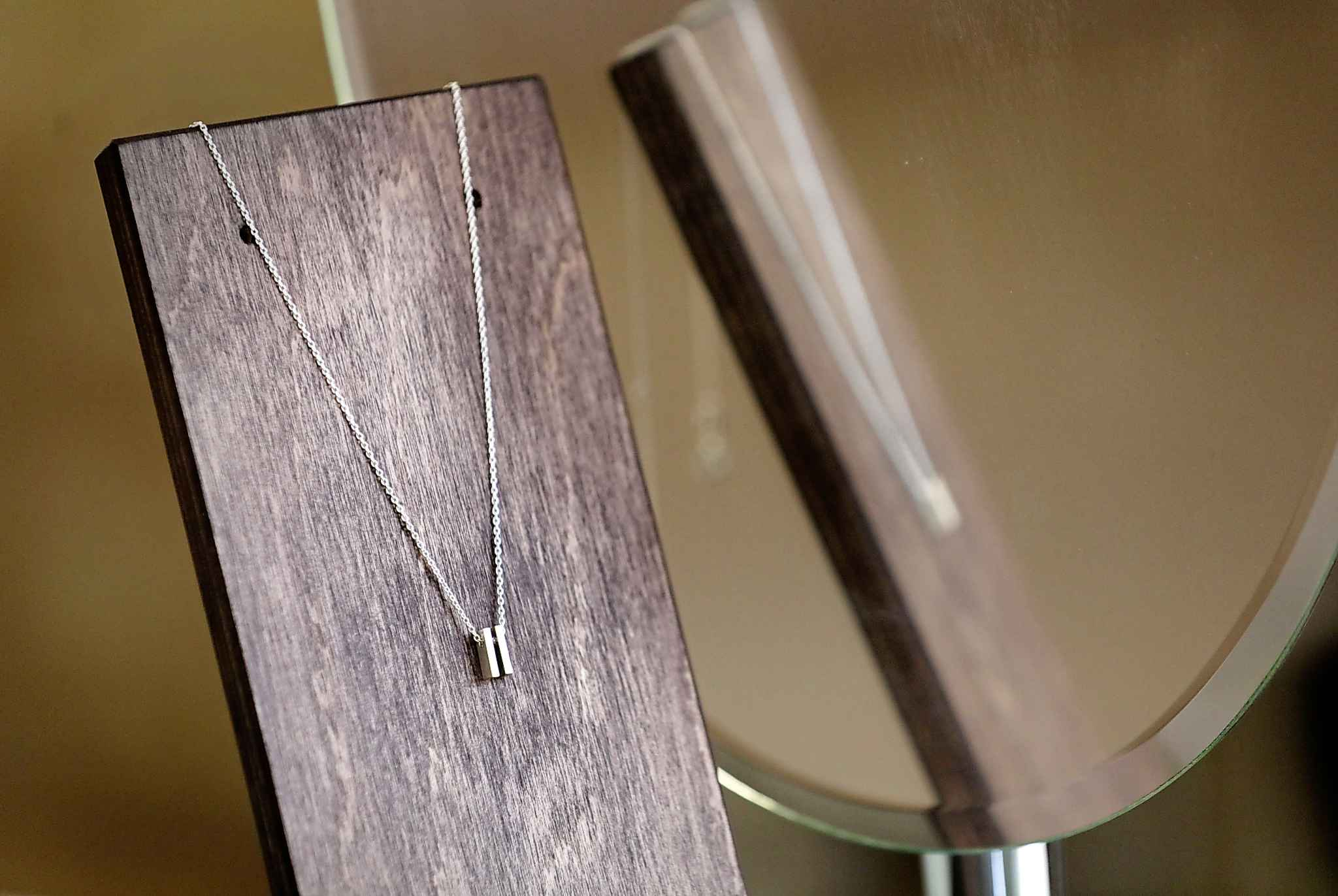 """RUTH BONNEVILLE  /  WINNIPEG FREE PRESS   The """"pause-itivity"""" necklace features a sterling silver """"pause symbol,"""" those two little vertical bars viewers see when they hit the pause button on their TV remote control."""