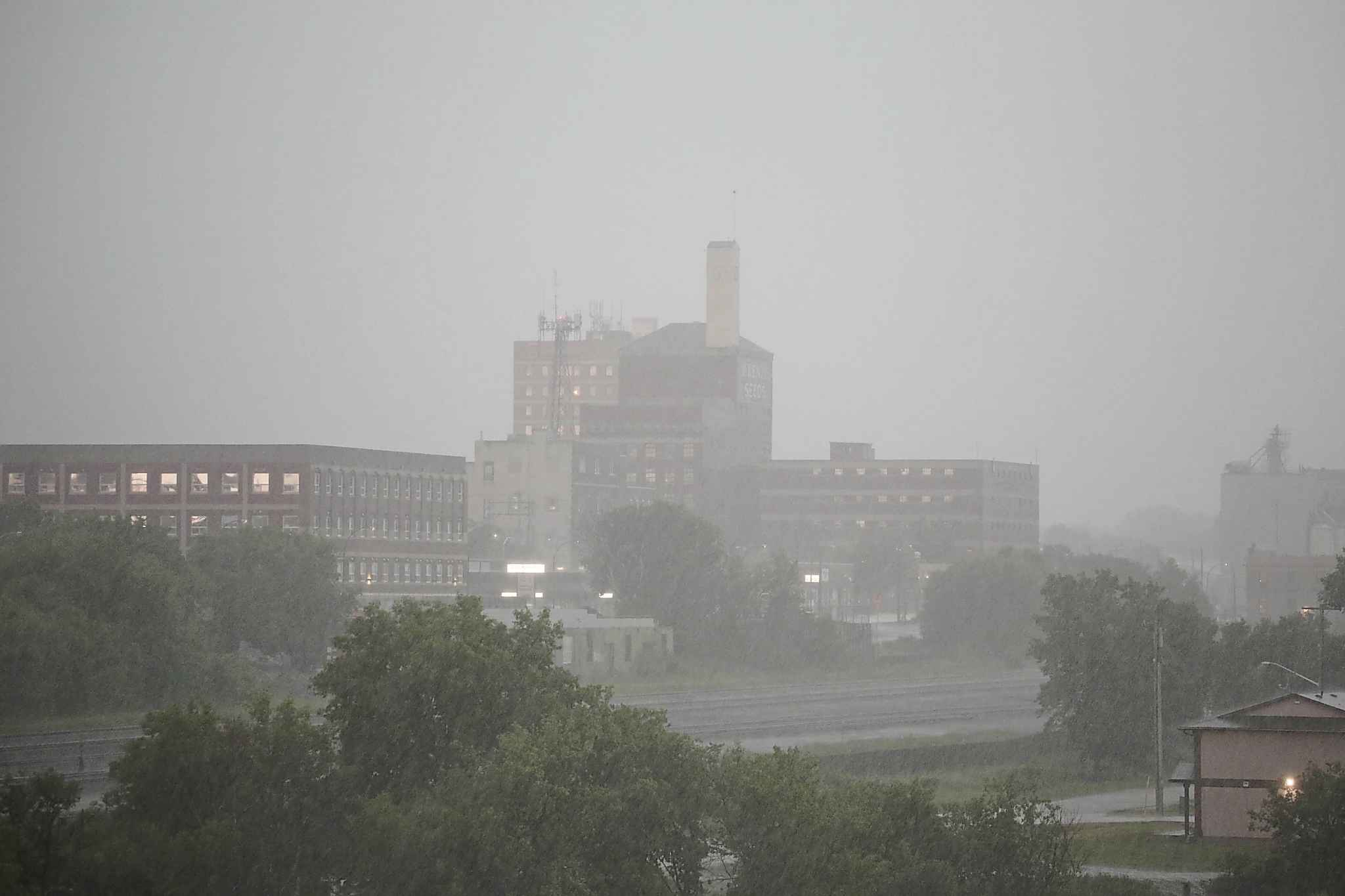 Downtown Brandon gets pelted with rain around 5 p.m. Sunday. As of Sunday evening, at 5:52 p.m, meteorologists from Environment Canada  warned about a line of thunderstorms that stretched from south of Elgin to just north of Dauphin Lake, traveling northeast at 25 kilometres an hour. (Kyle Darbyson/The Brandon Sun)