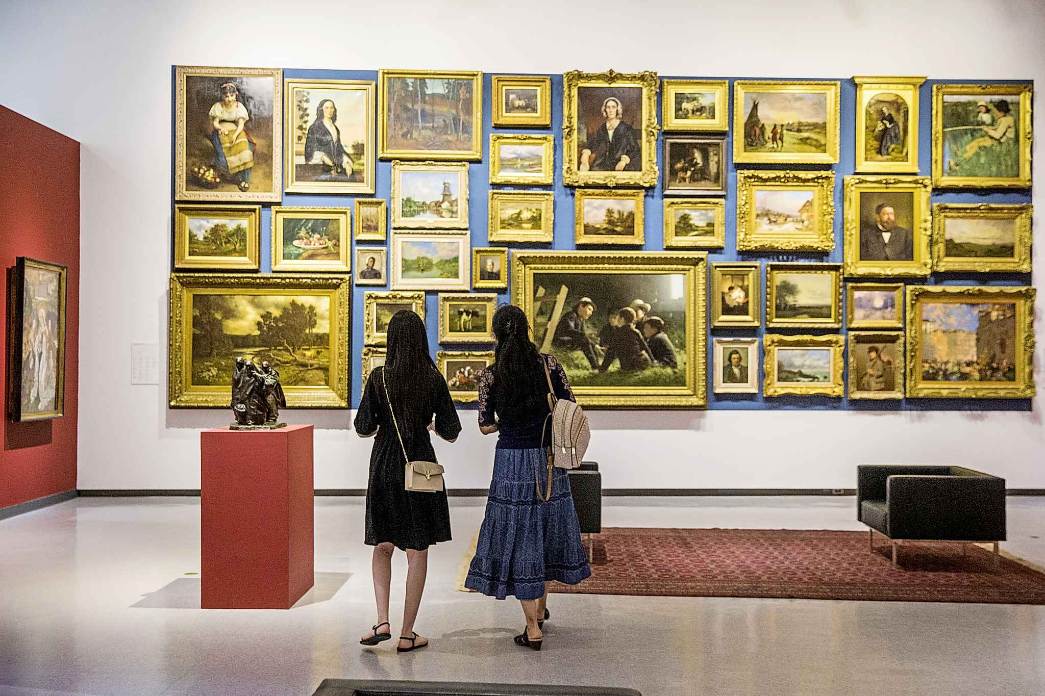 Linjie Huang (left) and her mom, Xuelian Zhang, look at art at the WAG. Even though they've lived in Winnipeg for two years, this was their first visit to the gallery. (Mikaela MacKenzie / Winnipeg Free Press)</p>