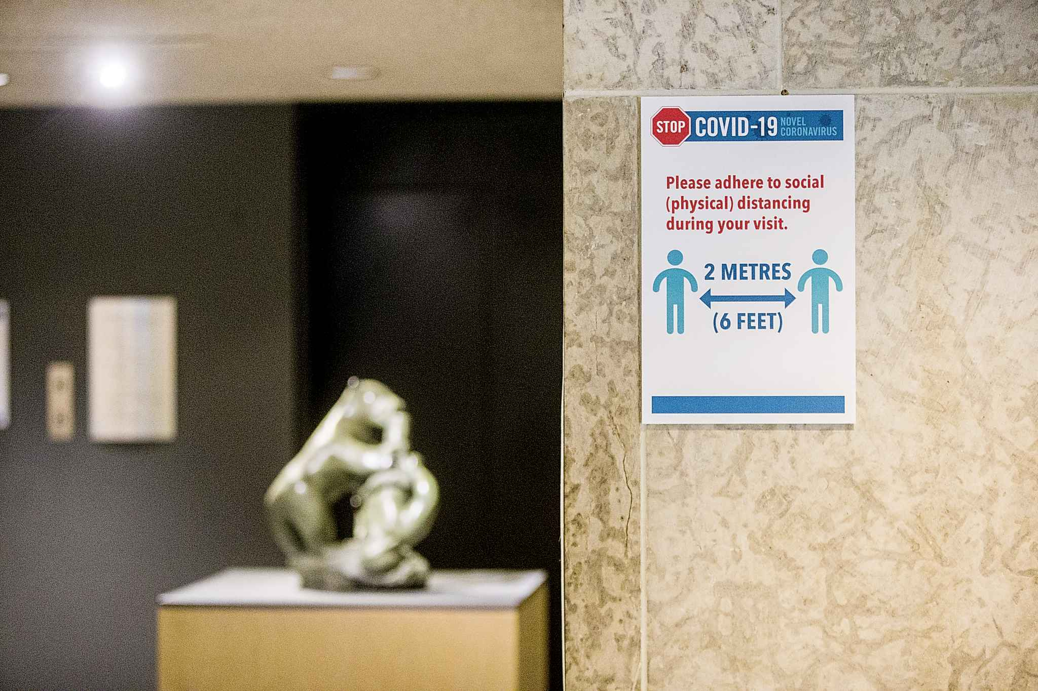 Signs encouraging social distancing at the WAG. The gallery hasn't experienced pushback from patrons who resent the questions and safety measures. (Mikaela MacKenzie / Winnipeg Free Press)</p>