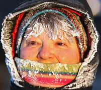 Eileen Belinsky is covered in frost while taking a seven-kilometre walk on Grant Avenue Friday morning.