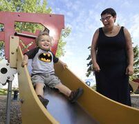Twenty-one-month-old Lachlan enjoys a slide on a beautiful Wednesday morning with his mother Heather Bidzinski in the park on Daly Street.