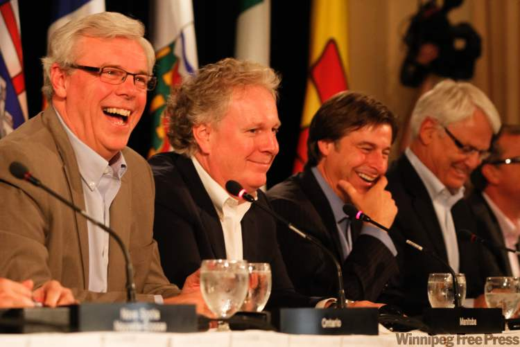 Premier Greg Selinger (left) shares a laugh with fellow premiers during a Friday-afternoon press conference ending the gathering of premiers.