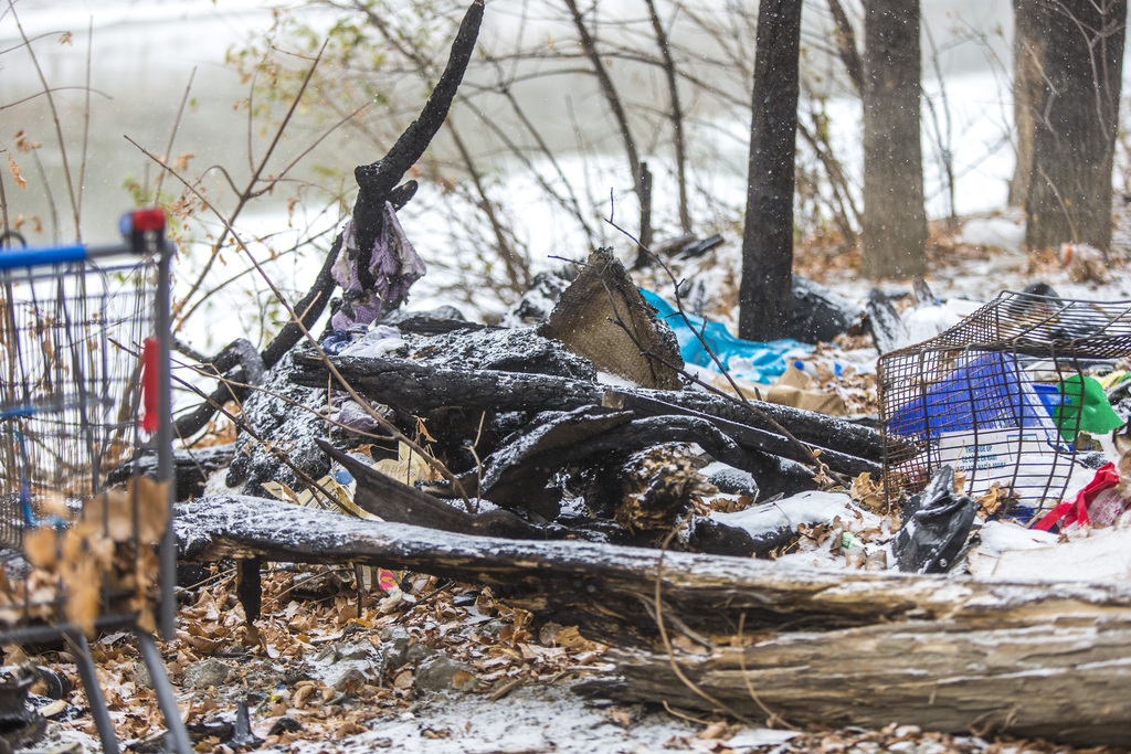 The fire department was at the homeless camp in West Broadway twice in 10 hours on Monday and Tuesday. (Mikaela MacKenzie / Winnipeg Free Press)