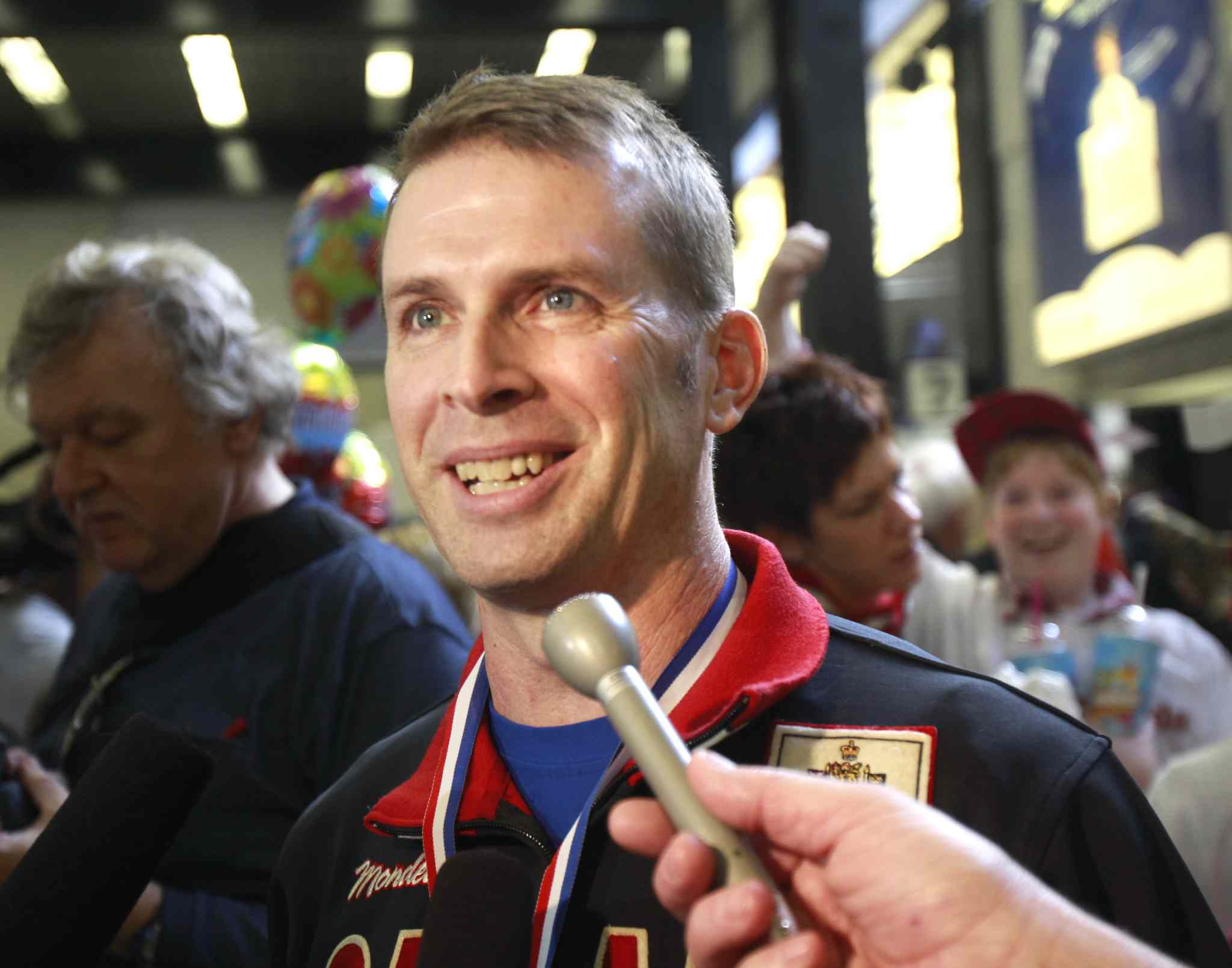 Team Canada skip Jeff Stoughton and his teammates were met by family and supporters at the Winnipeg airport after winning the 2011 World Men's Curling Championship.