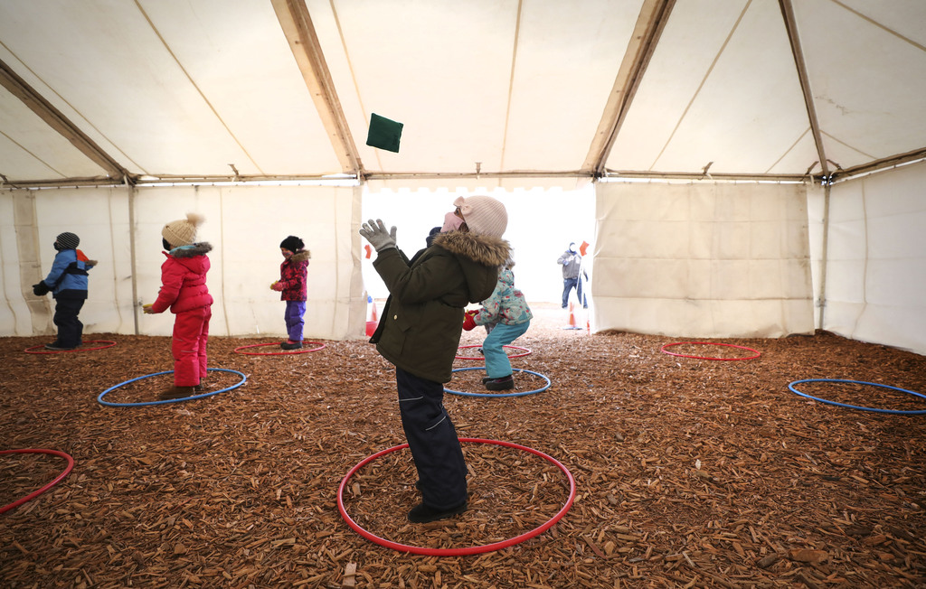 The tents aren't heated, but the shelter cuts down on the wind chill factor, educators say. (Ruth Bonneville / Winnipeg Free Press)