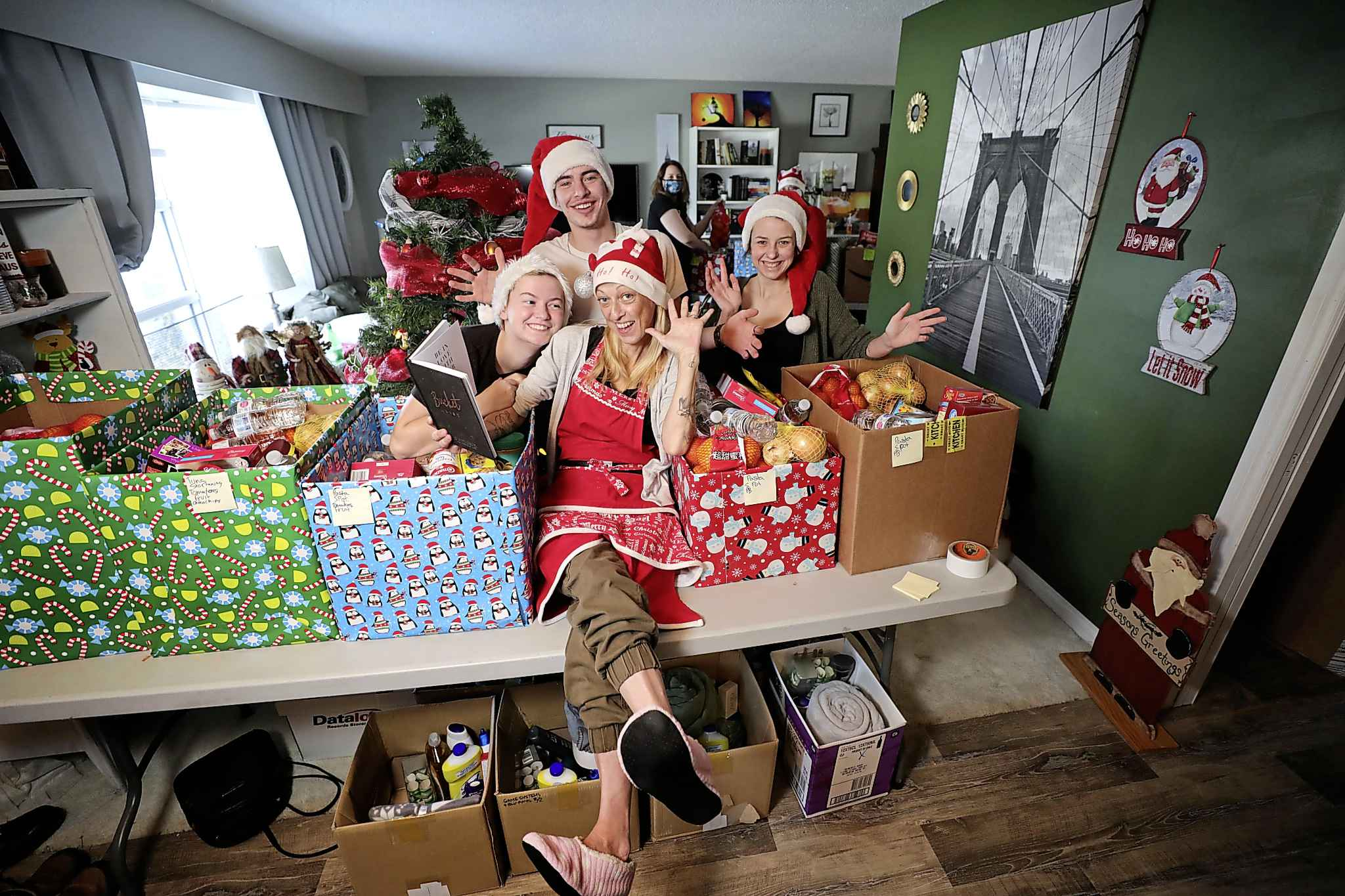 RUTH BONNEVILLE / WINNIPEG FREE PRESS  Jaime created South Winnipeg Assists Santa, a Fort Richmond community group that has put together Christmas hampers they will be delivering to 11 local families on Tuesday night.