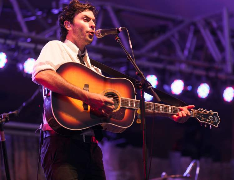 Jonathan Russell, singer and guitarist for the Head and the Heart, performs at the Winnipeg Folk Festival.