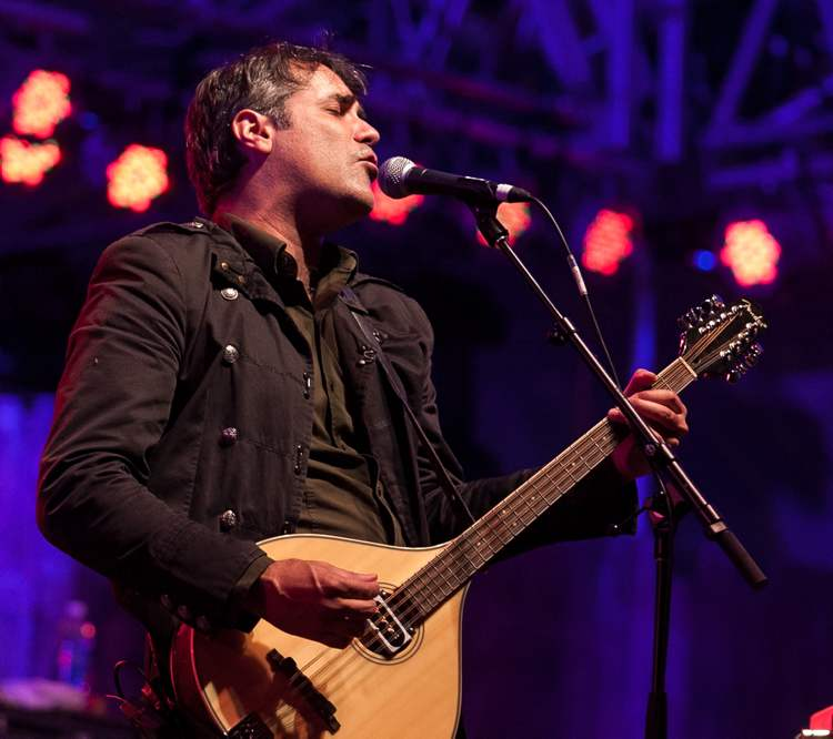 Nick Urata, singer and multi-instrumentalist with DeVotchKa, performs during the headlining act on Saturday night at the Winnipeg Folk Festival. (Melissa Tait / Winnipeg Free Press)