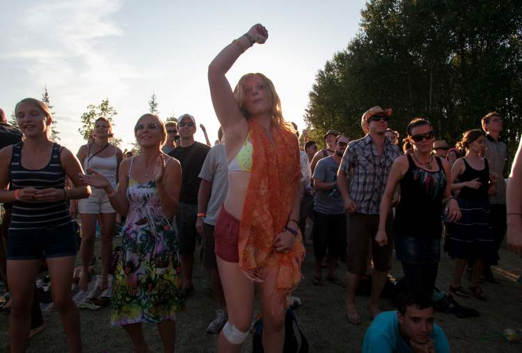 Emma Farmer dances during the Folk Festival Saturday.